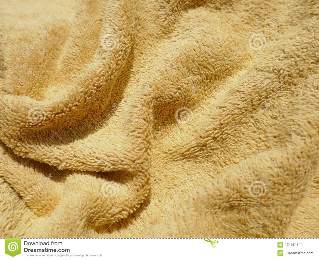Golden Brown Background Of Soft, Fluffy, Terry Cloth Or