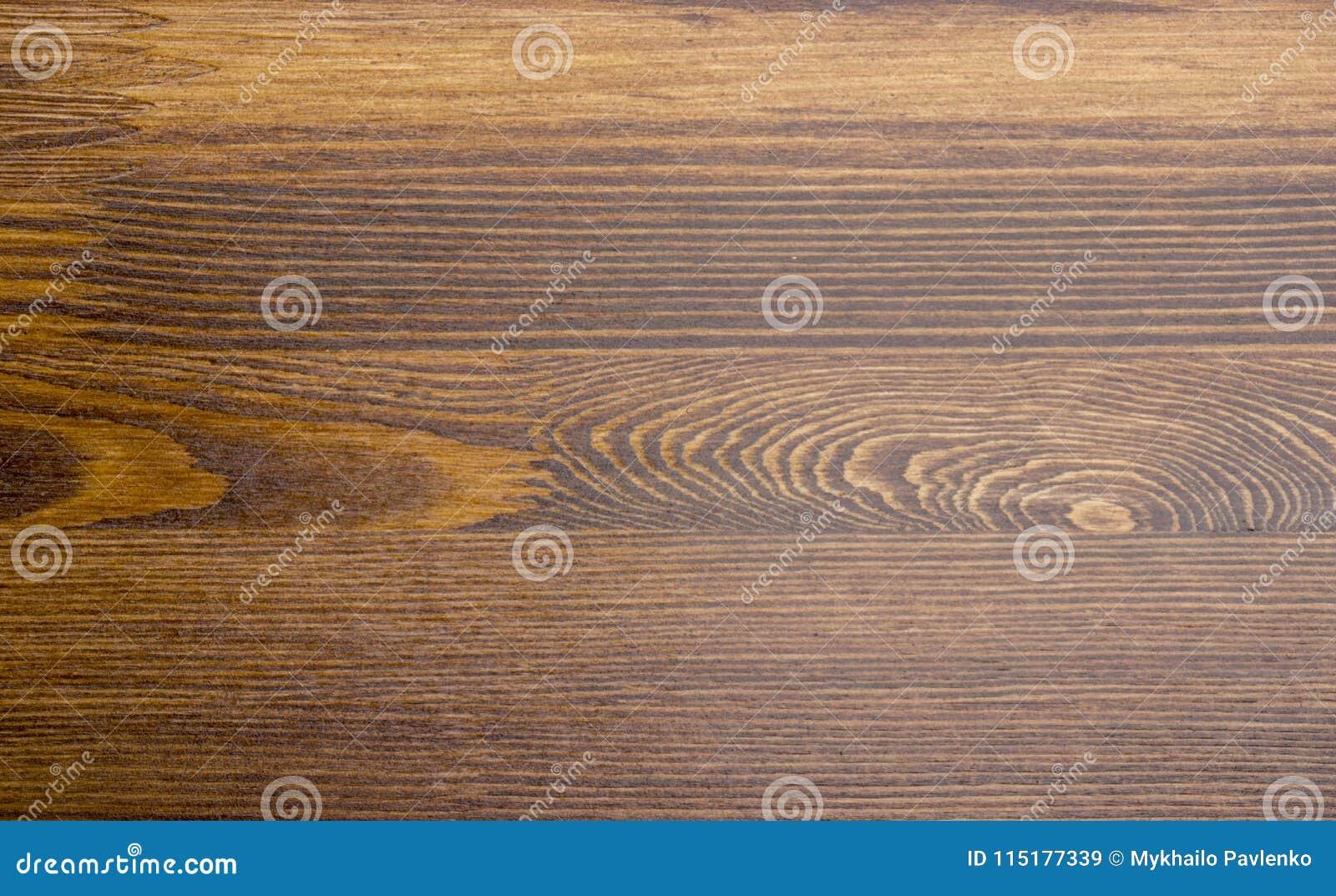Texture brune en bois de grain, vue supérieure du fond en bois de mur de table en bois