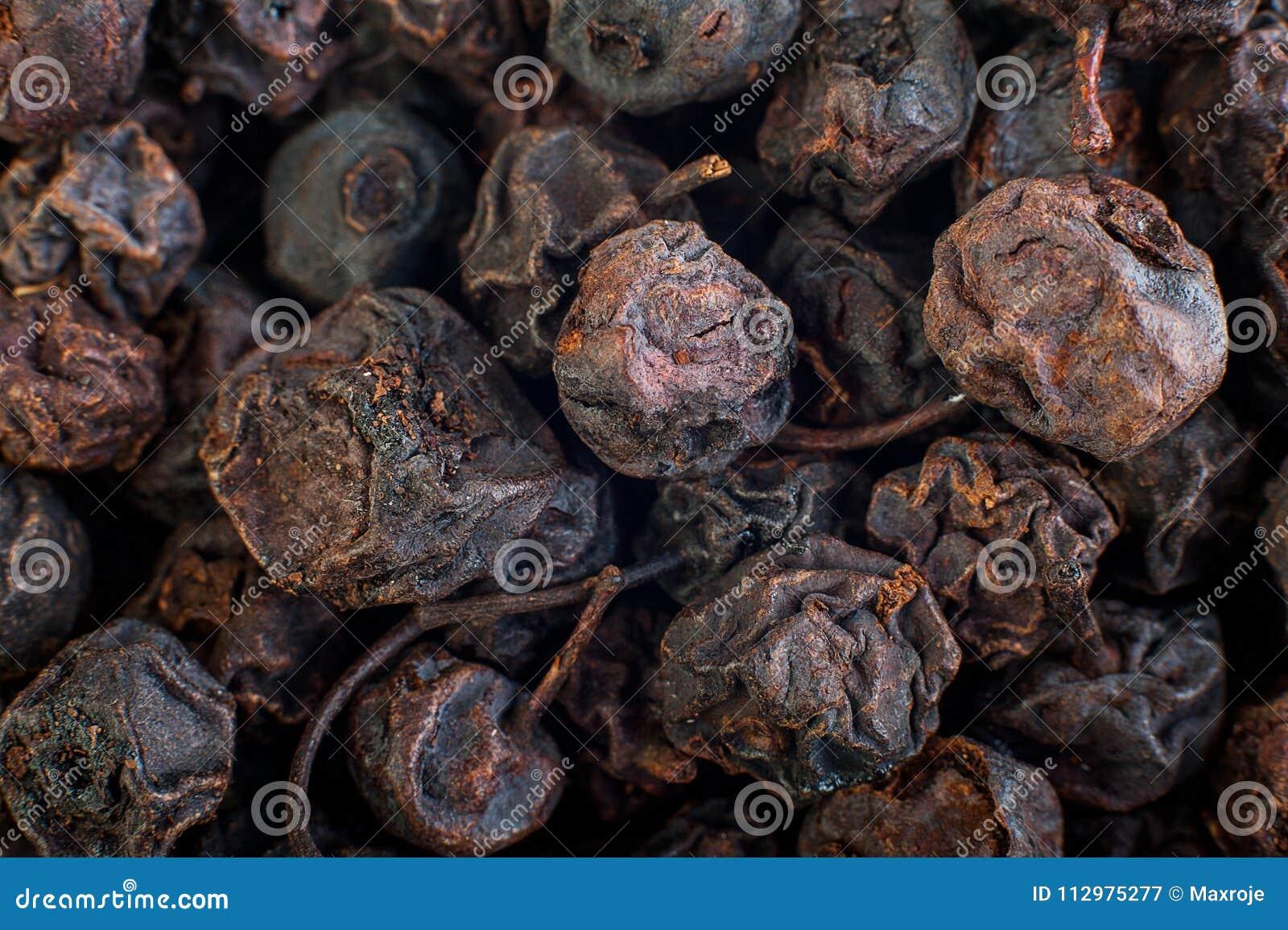 Texture of dried black berries, food background