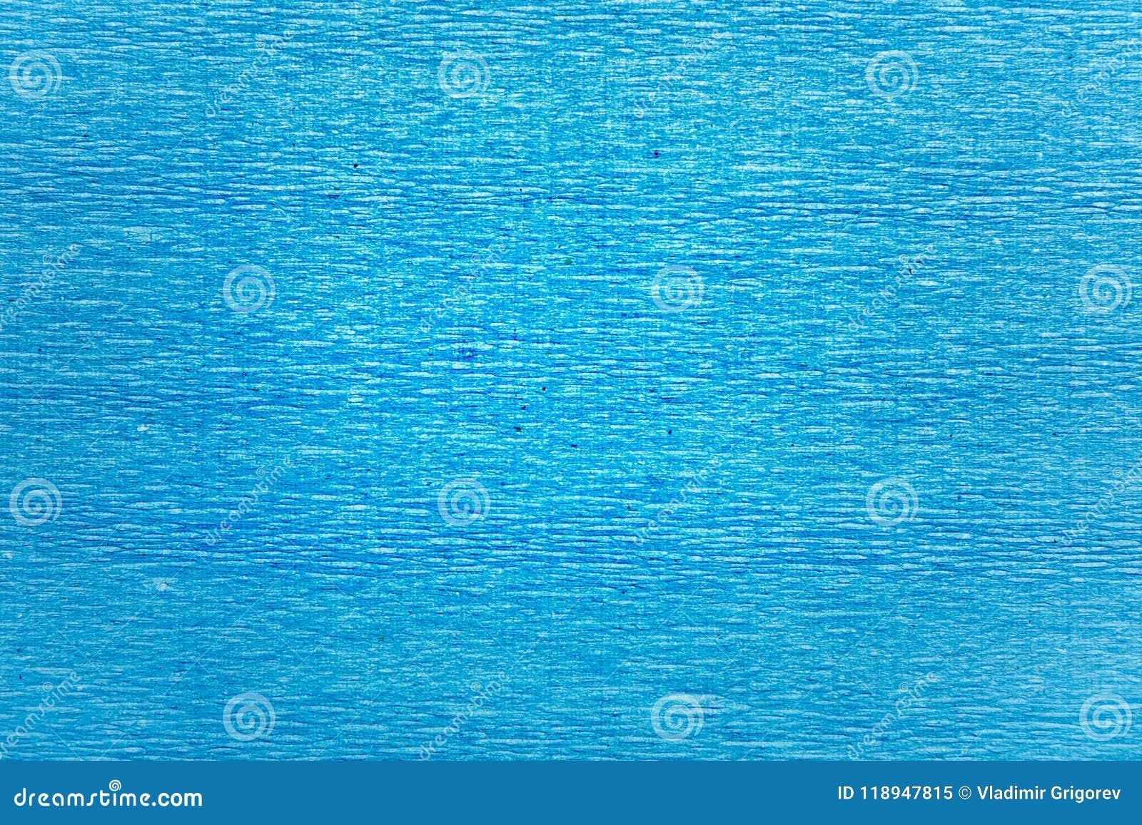 Texture de contexte de papier ondulé froissé par bleu