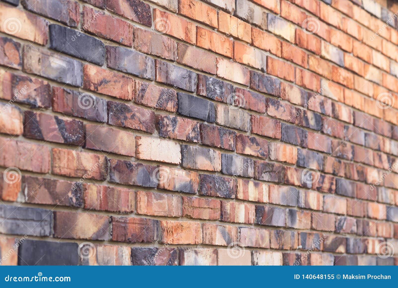 Texture de fond de mur de briques brûlé rouge, maison de maçonnerie