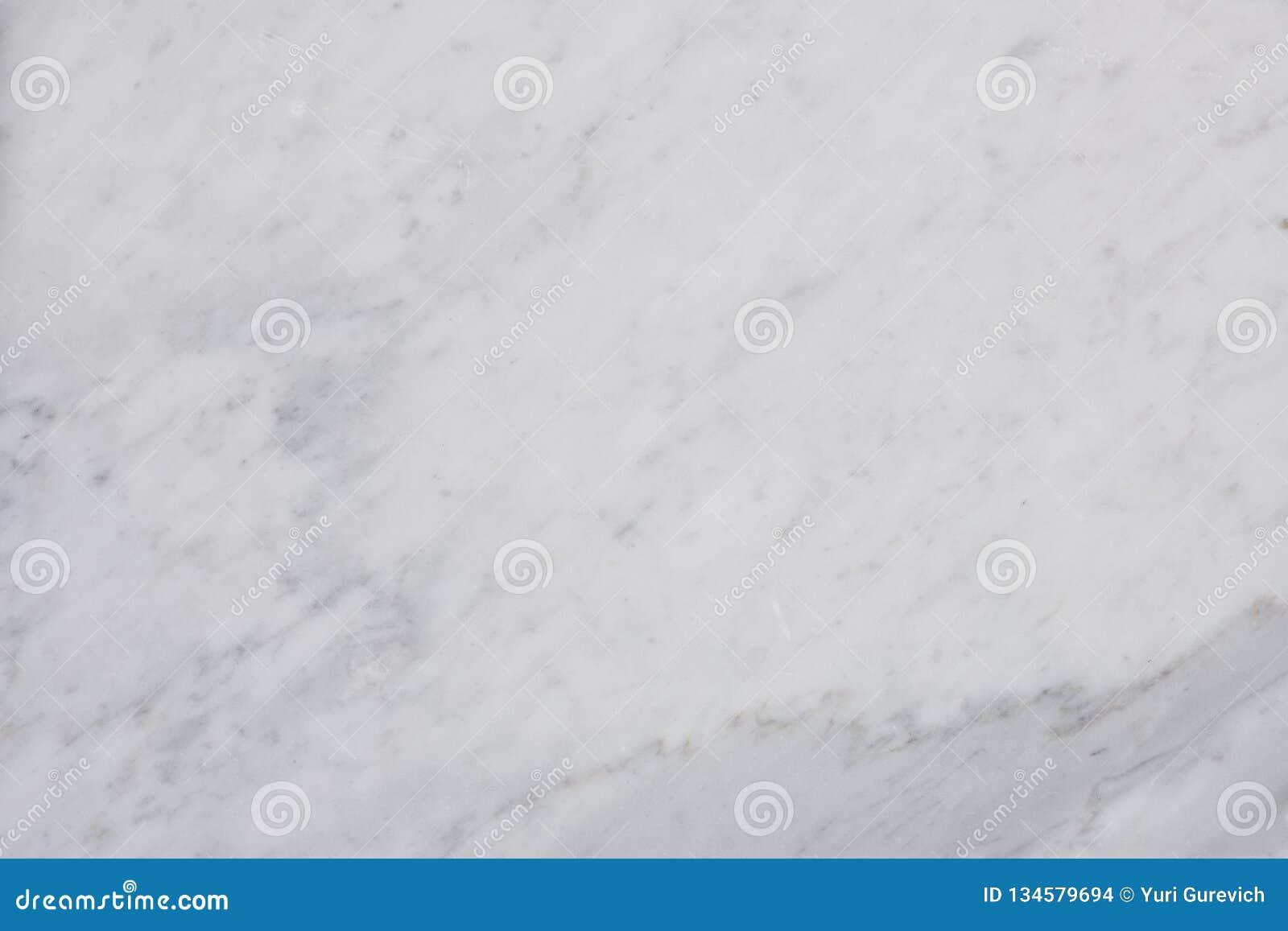 Texture de marbre blanche pour le fond luxueux de papier peint de tuile de peau