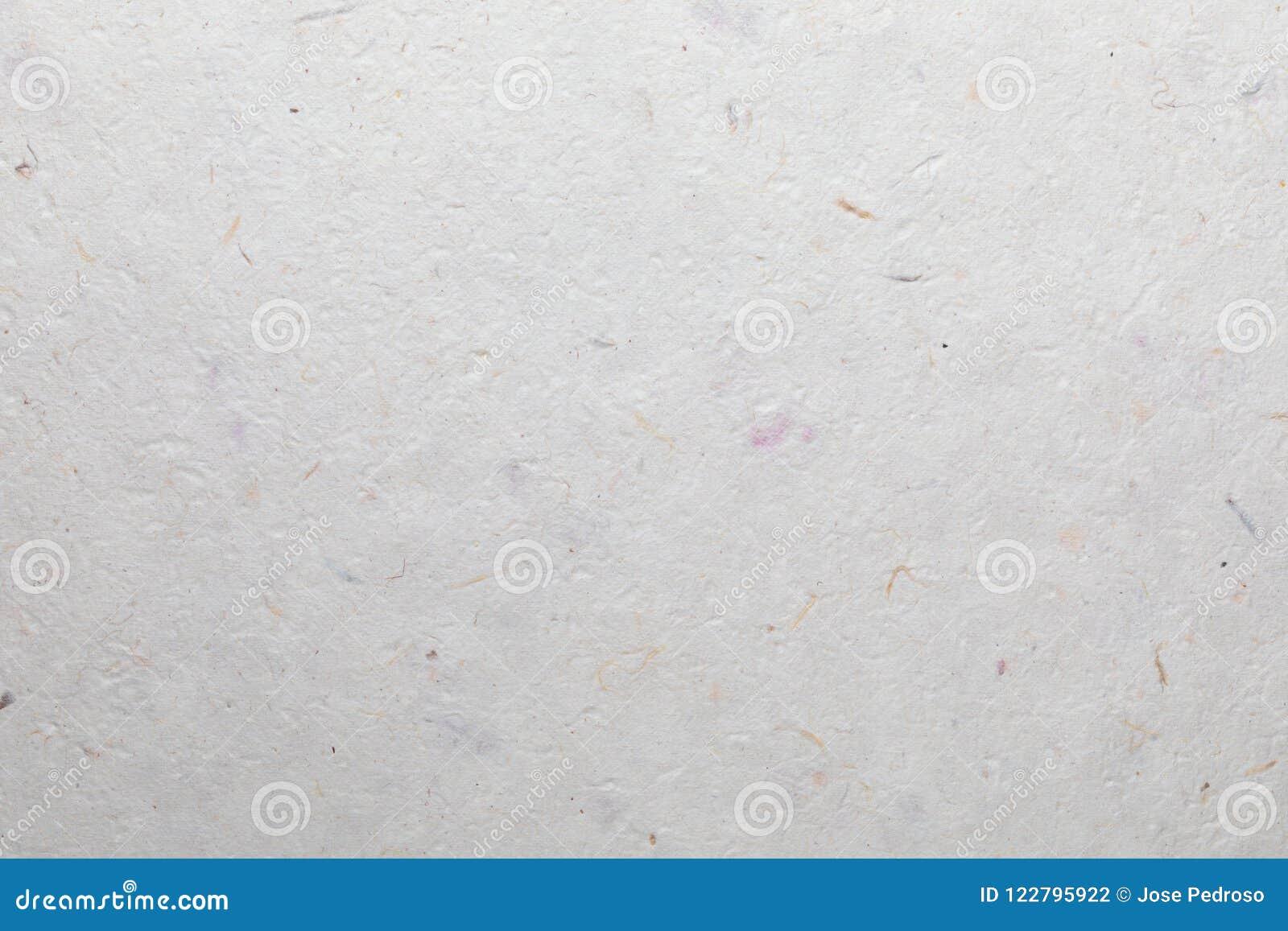 Texture de papier fait main avec les matériaux réutilisés