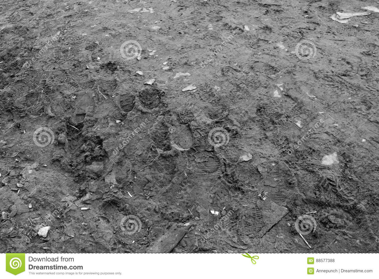 Texture of earth with garbage and footprints.