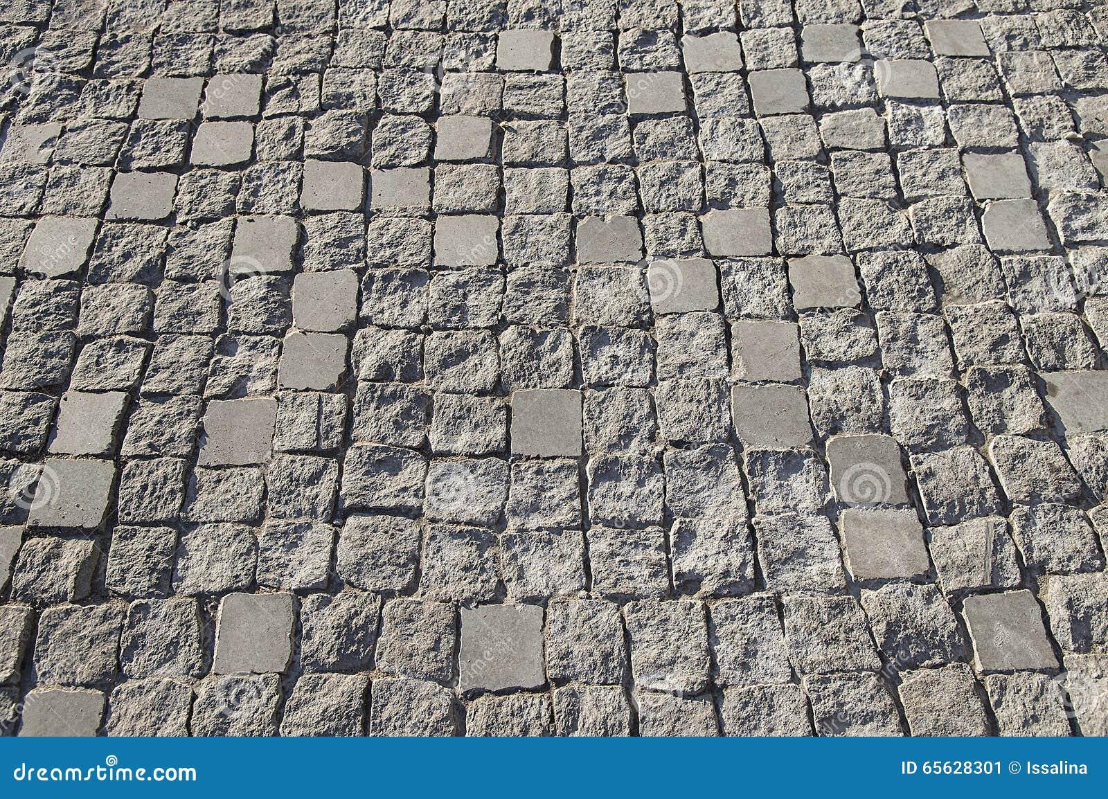 Texture en pierre gris-clair de fond de trottoir