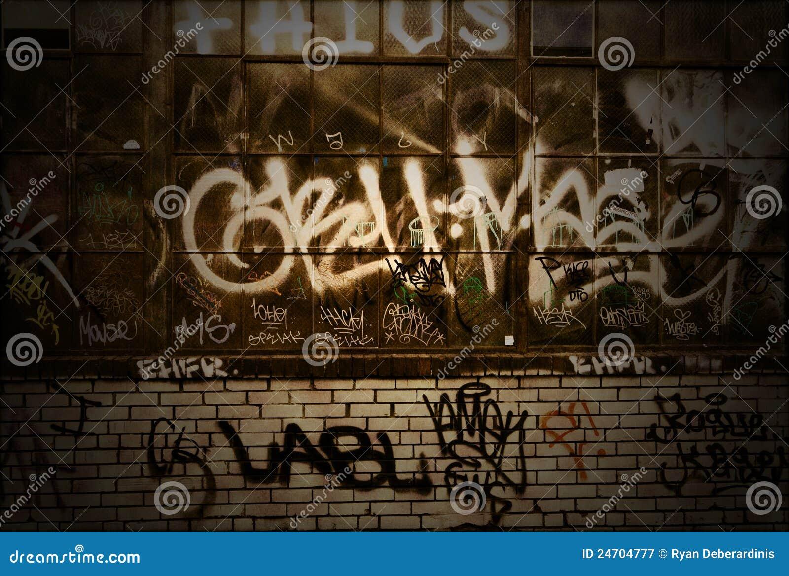 Texture grunge de fond de mur de briques de graffiti