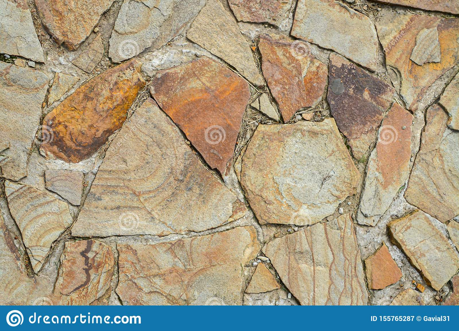 Texture of large flat stones. Abstract natural background. The concept of masonry made from natural, unprocessed stones