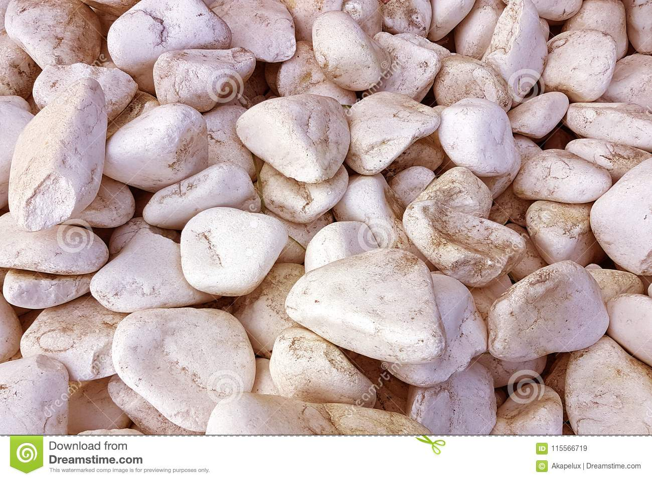 Texture: large sanded gravel.Fine white chalk stones of a sepia tone. Artistic reliefs from natural objects.