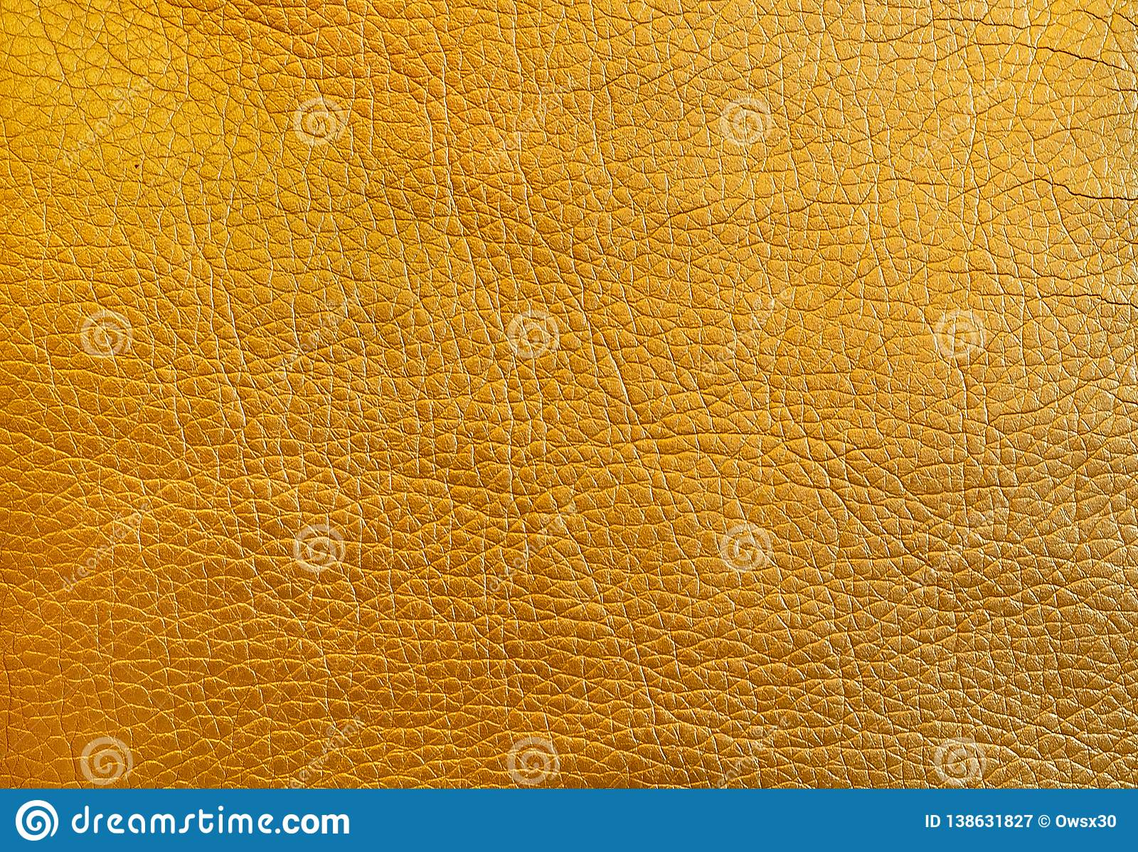 Texture metallic gold leather as a background. close up