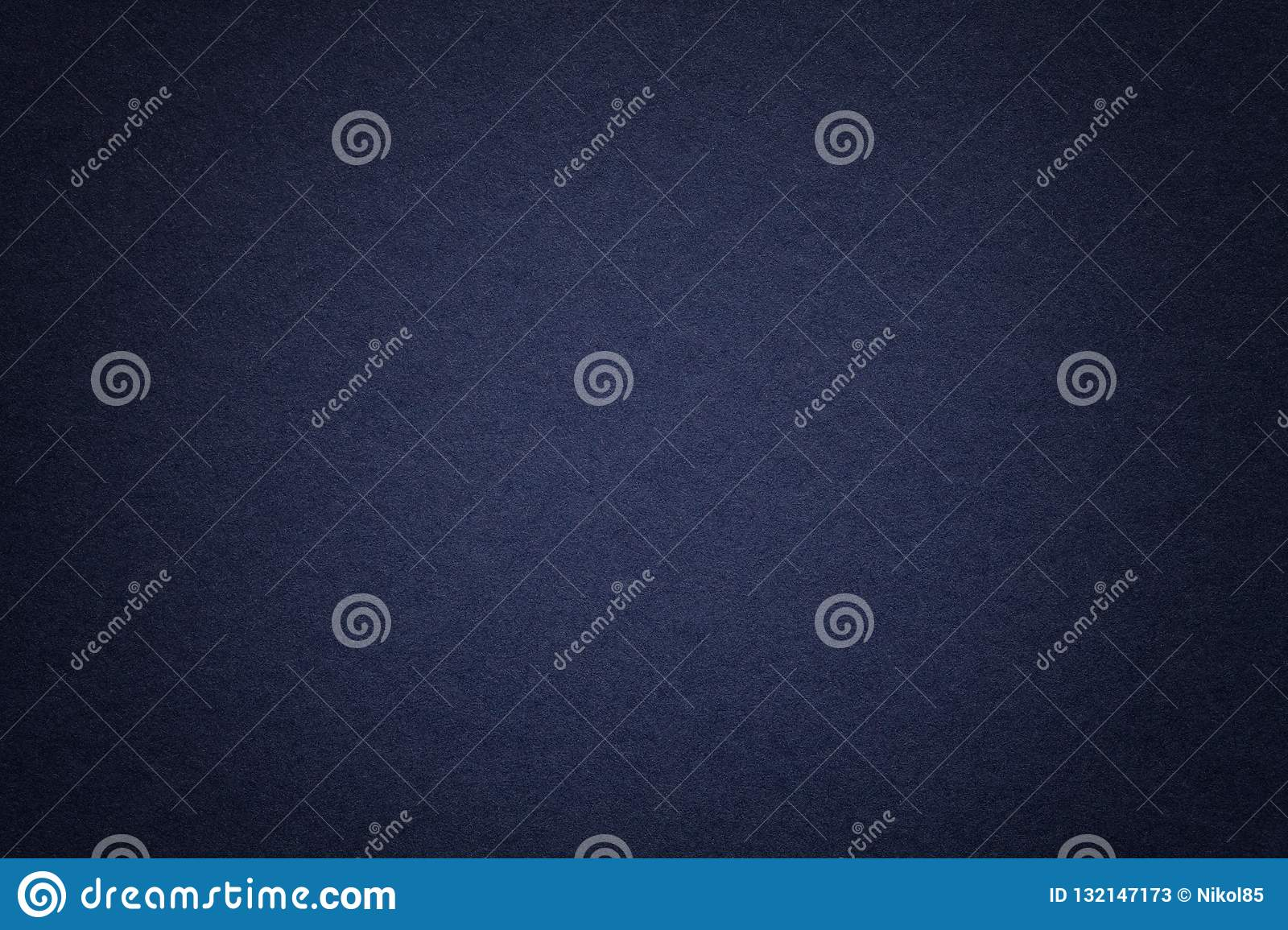 Texture of old navy blue paper background, closeup. Structure of dense cardboard