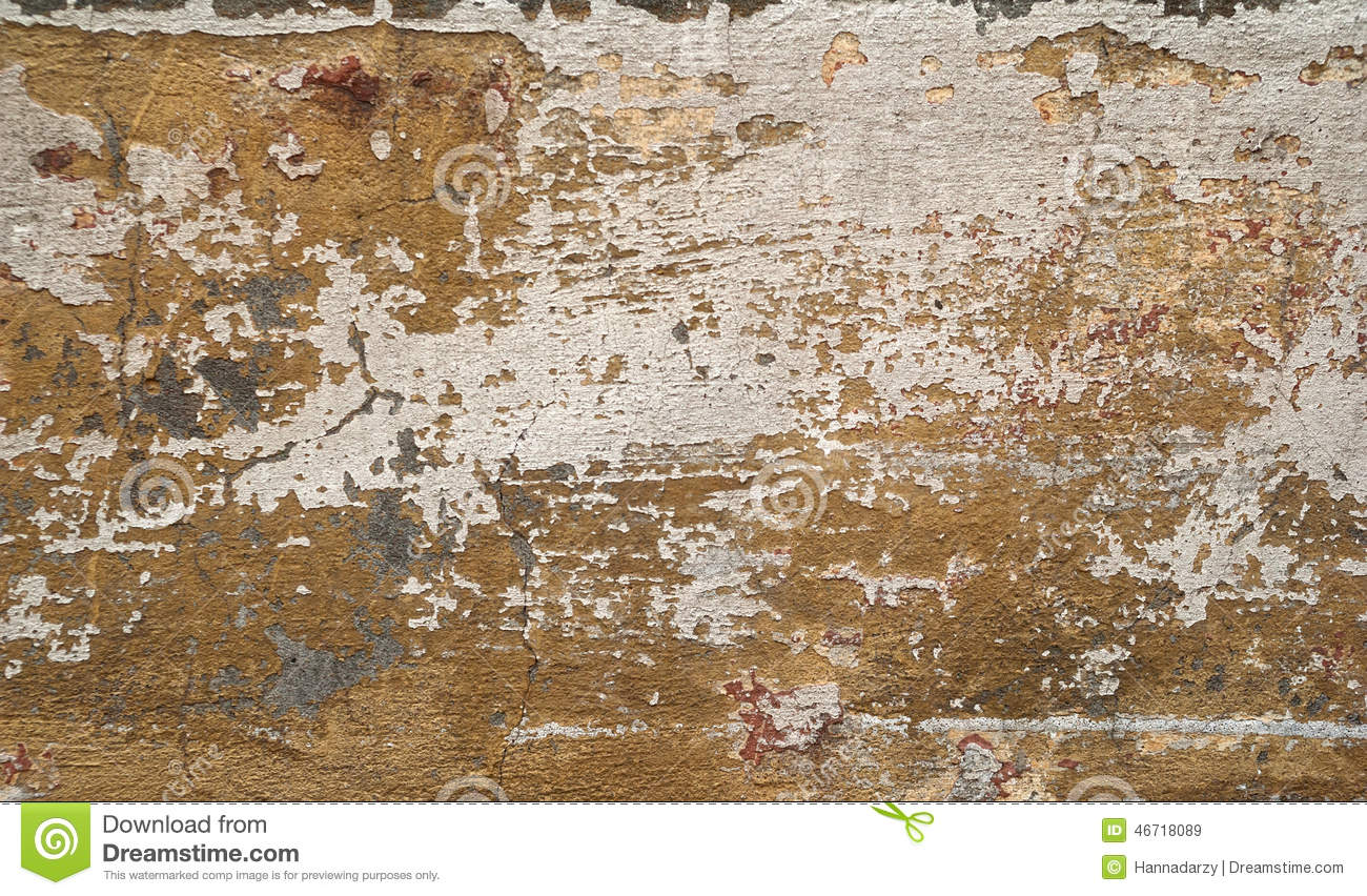 Texture Of Old Wall Covered With Yellow Stucco Stock Photo