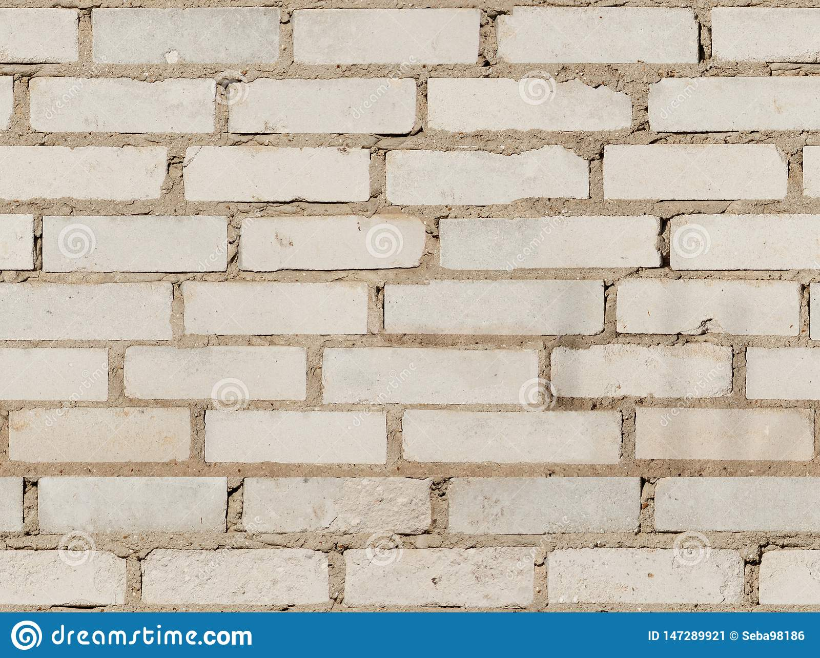 Texture of the old white brick wall