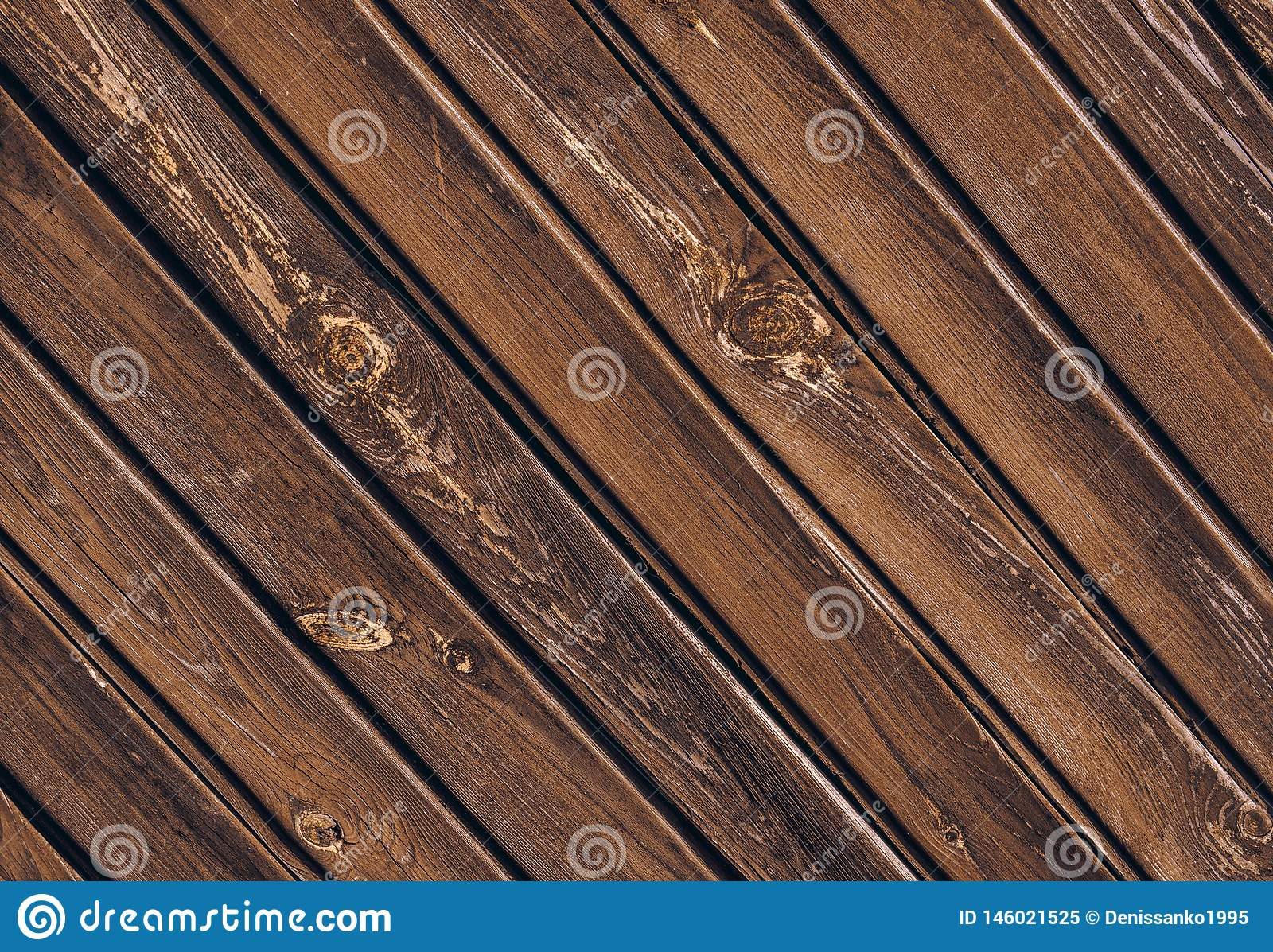 Texture of old wooden fence with skew boards