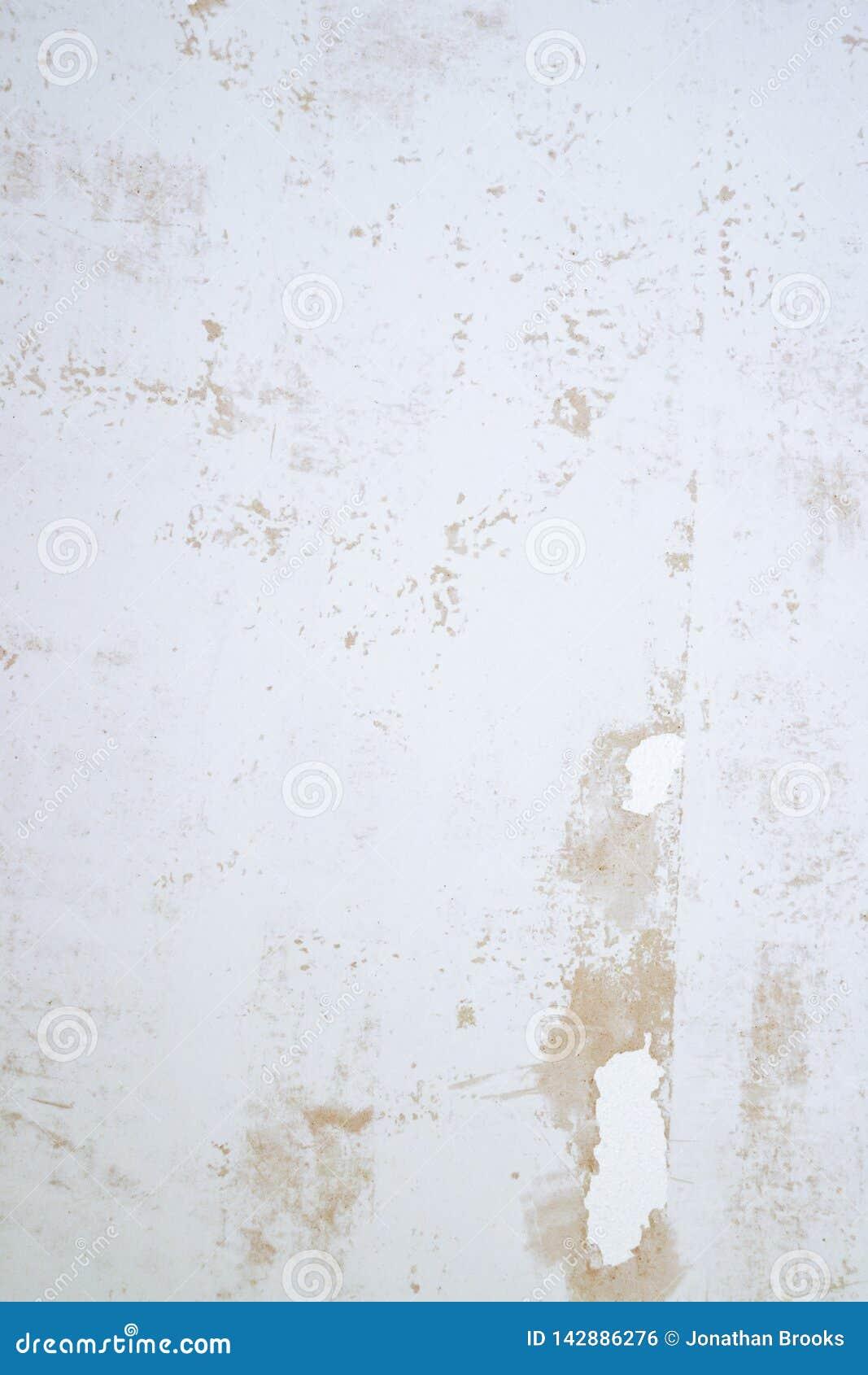 Texture plâtrée de mur avec des flocons de peinture et de remplisseur Surface poncée avec des imperfections