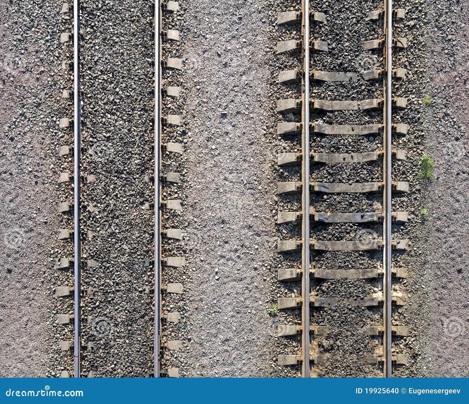 Texture of railway tracks on gravel