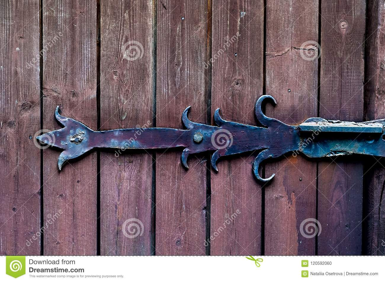Texture smooth wooden boards painted with age with vintage iron loop, natural light, copy space,