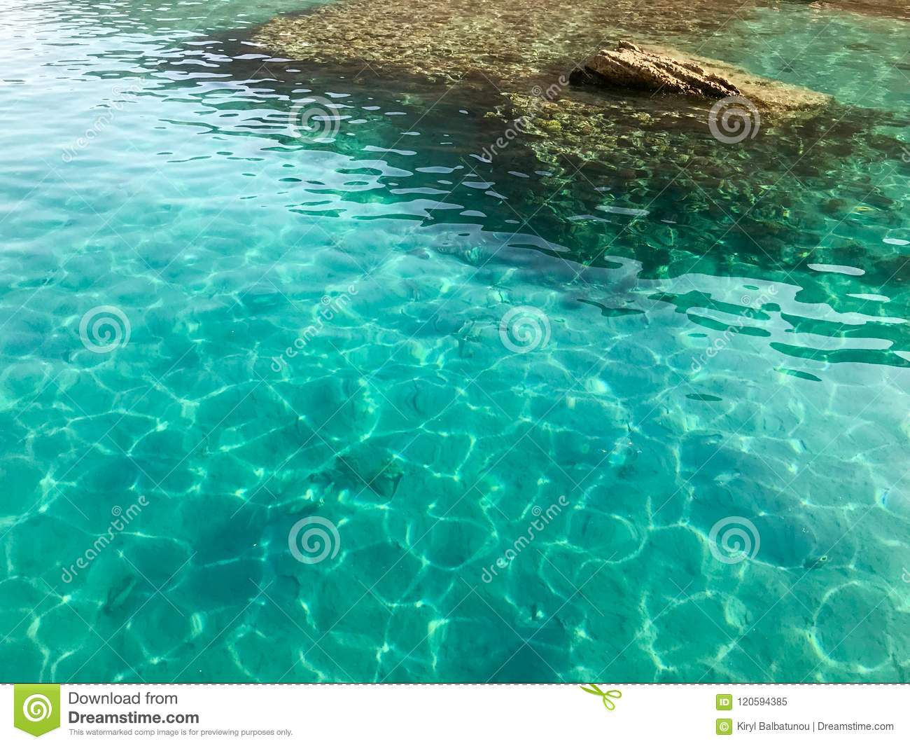 The texture is transparent wet blue light iridescent sea salt water, sea, ocean with waves, ripples with the bottom of beautiful c