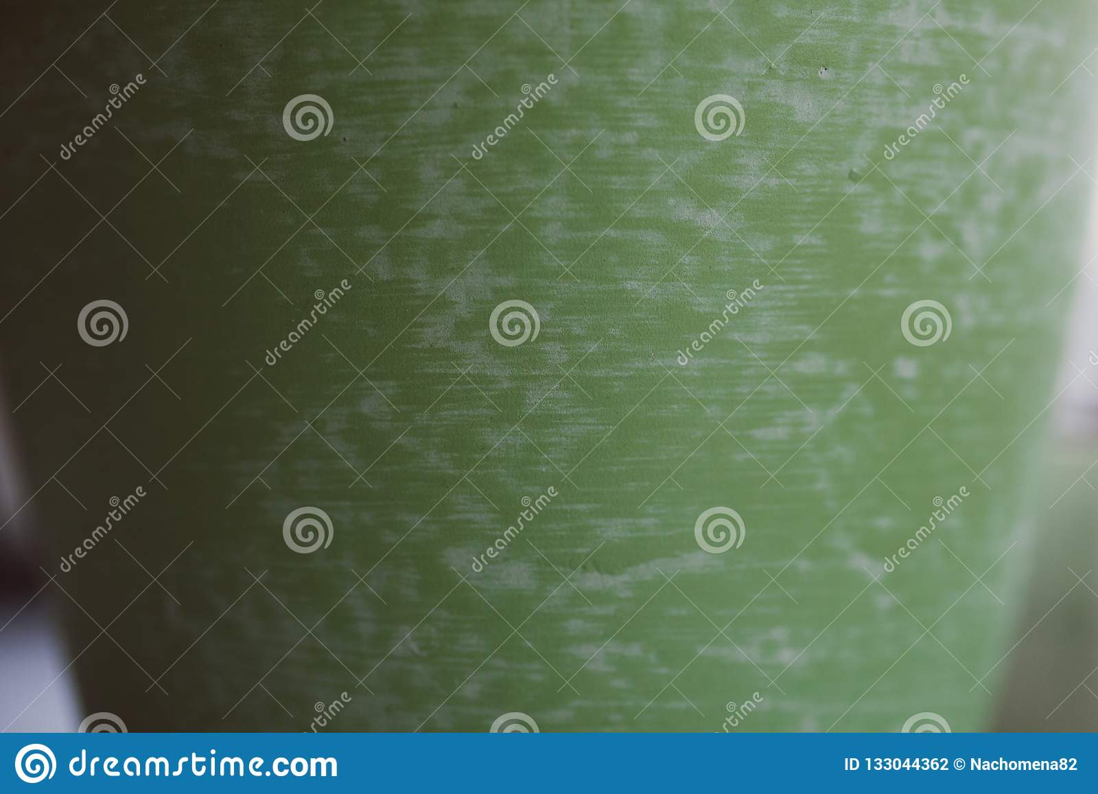 Texture verte de la poterie faite main Vue haute étroite de la surface en céramique verte