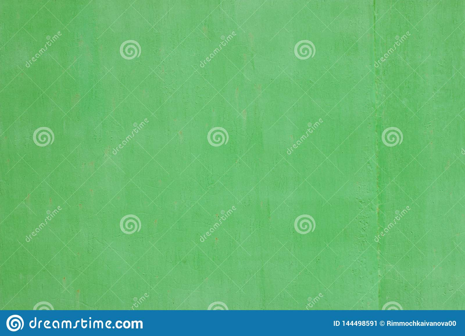 The texture of the wall painting in beautiful light green tones. Shot close up