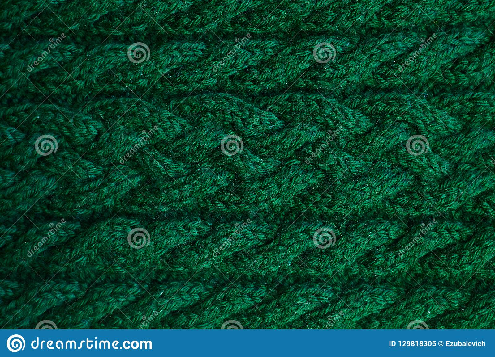 Texture of warm green knitted winter clothes.