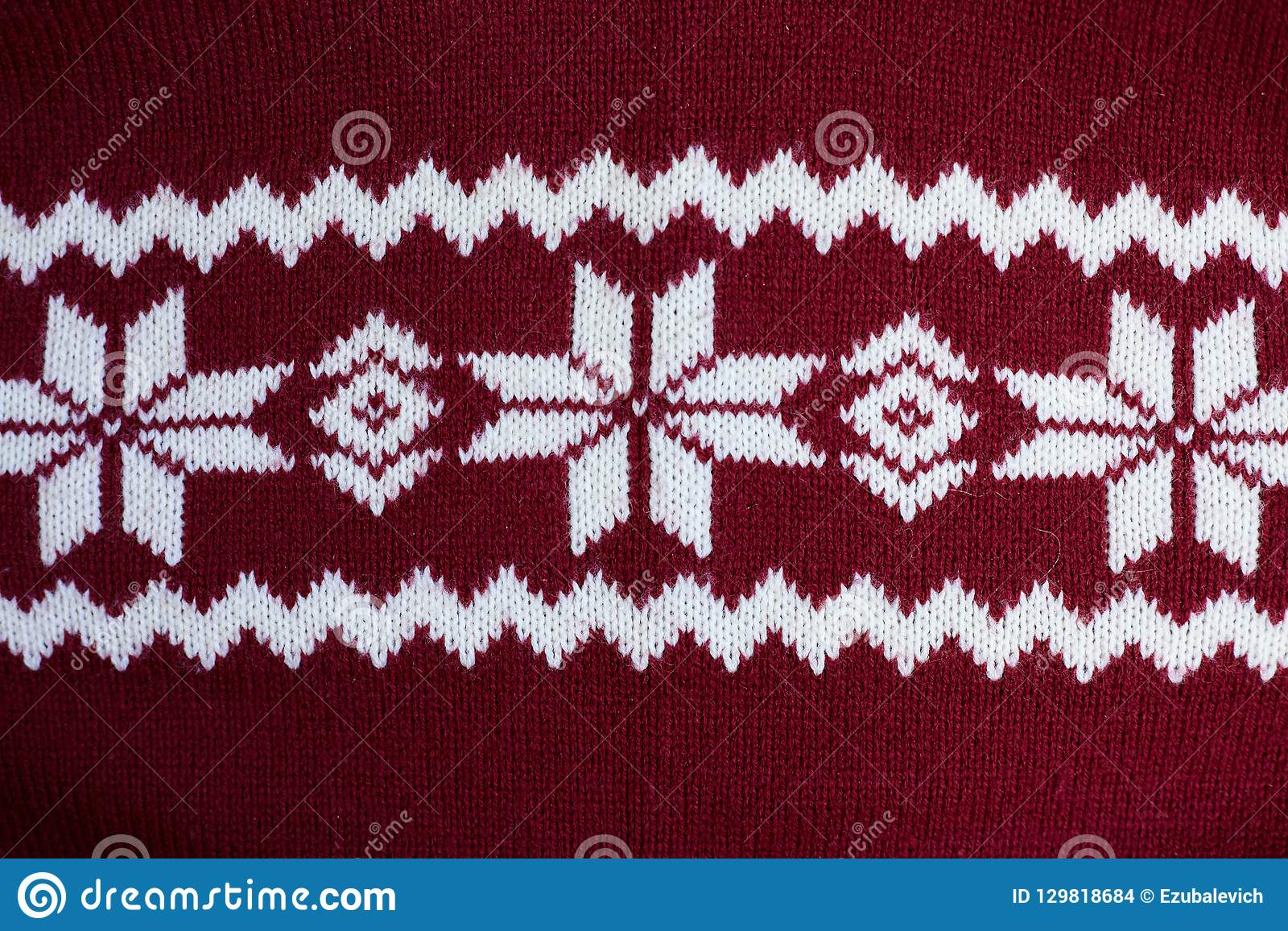 Texture of warm knitted motley clothes.