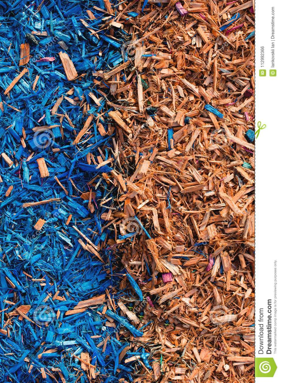 Textured background decorative colored sawdust for finishing flowerbeds in the winter season. Yellow orange sawdust