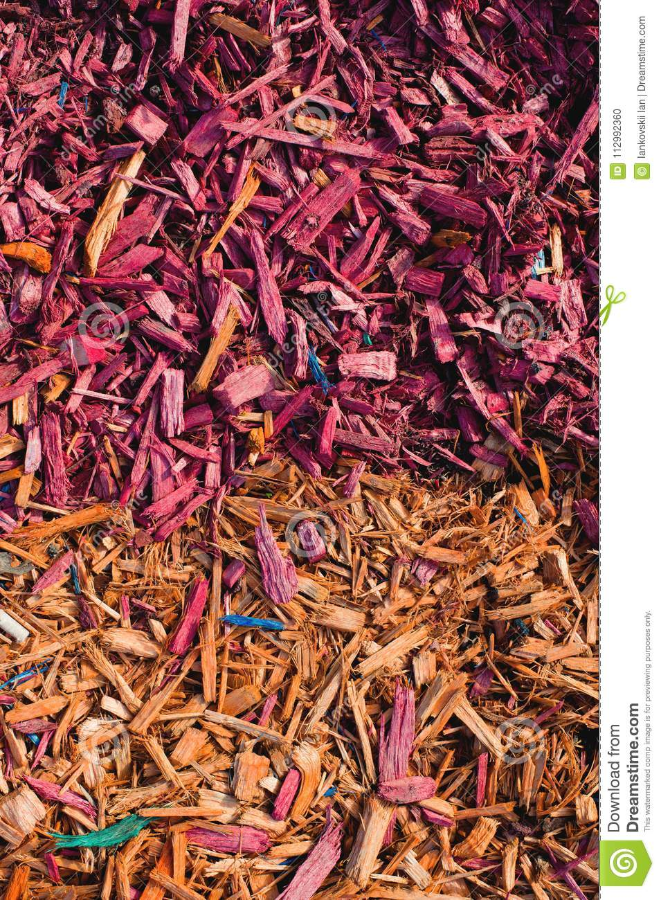 Textured background decorative colored sawdust for finishing flowerbeds in the winter season. Yellow red sawdust