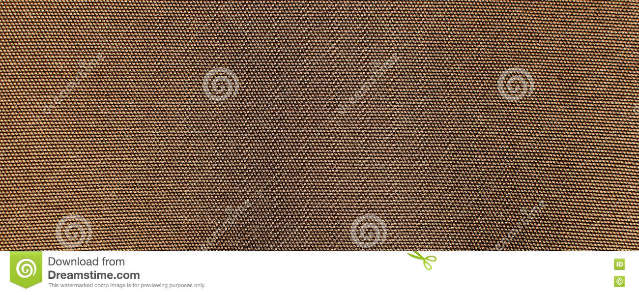 The textured background or wallpaper from rough cotton fabric of khaki color