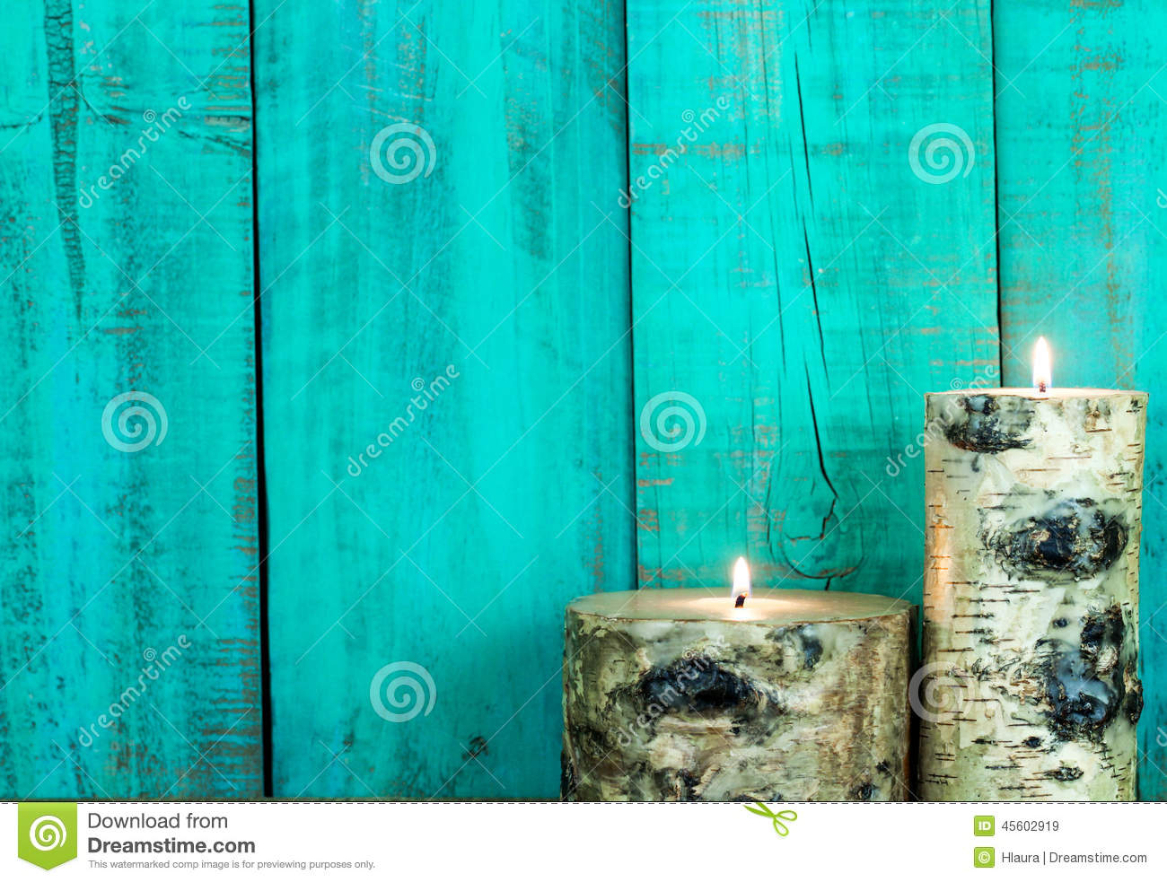 Textured Log Candles Burning By Antique Teal Blue Wooden