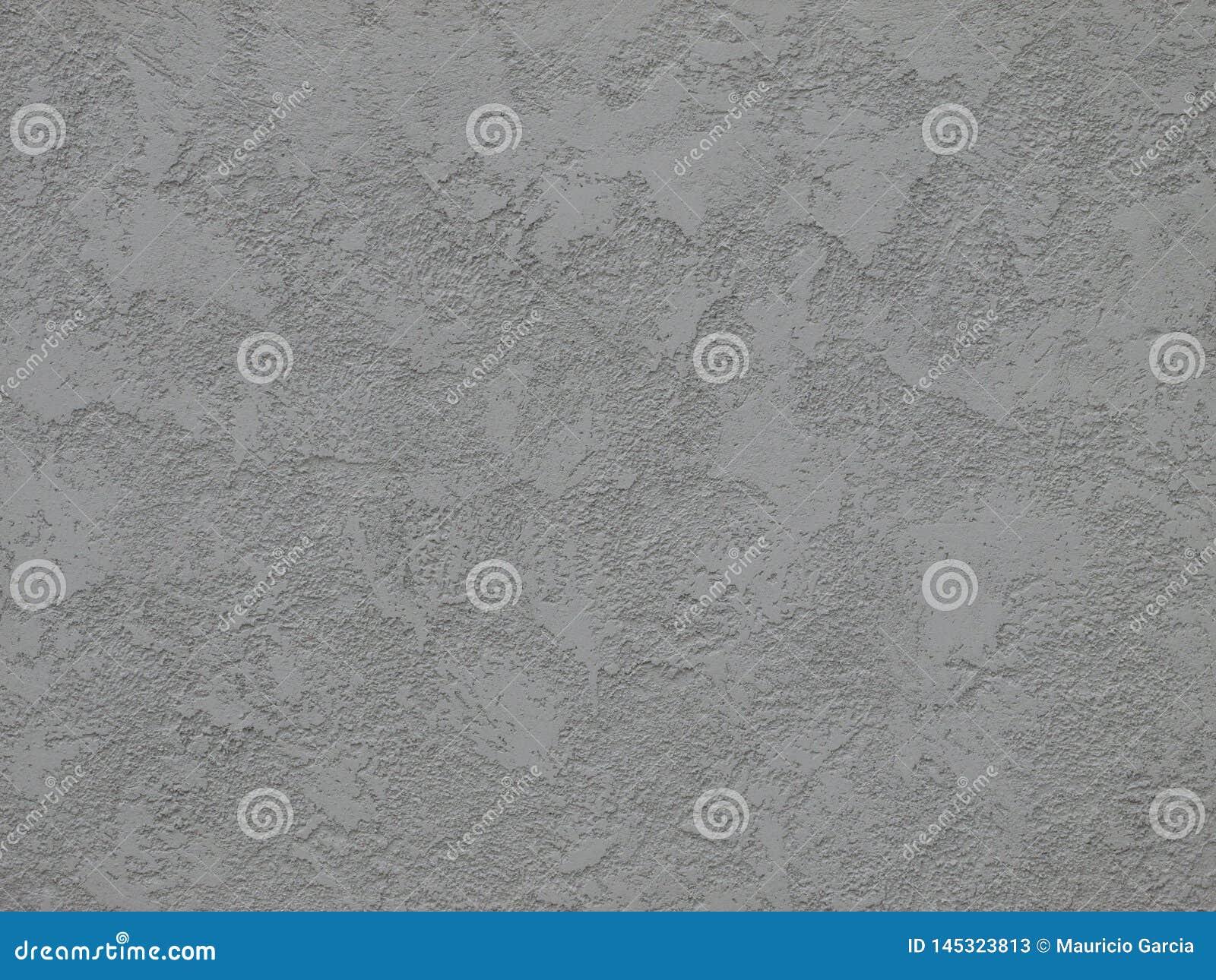 Texturerad betongvägg i grått ljus -