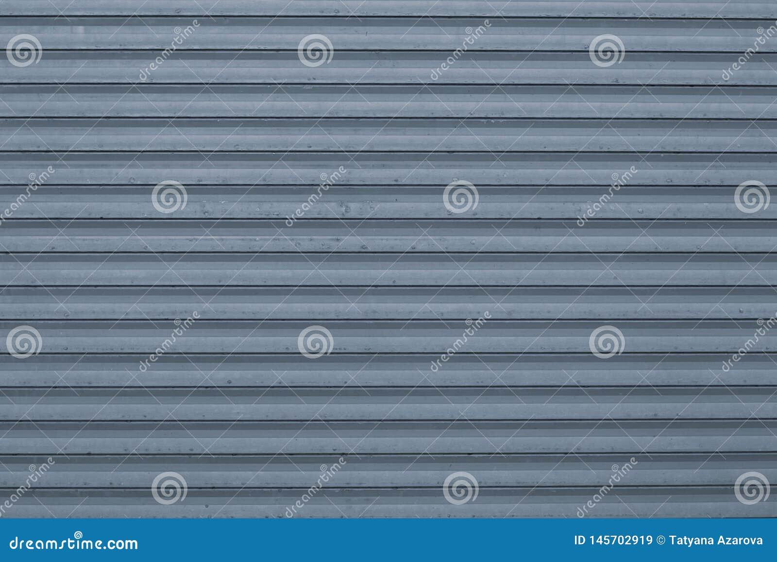 Textuur van blauwe en grijze golf metaaloppervlakte Blauwe geribbelde achtergrond met strepen, rechte lijnen Modern patroon van b