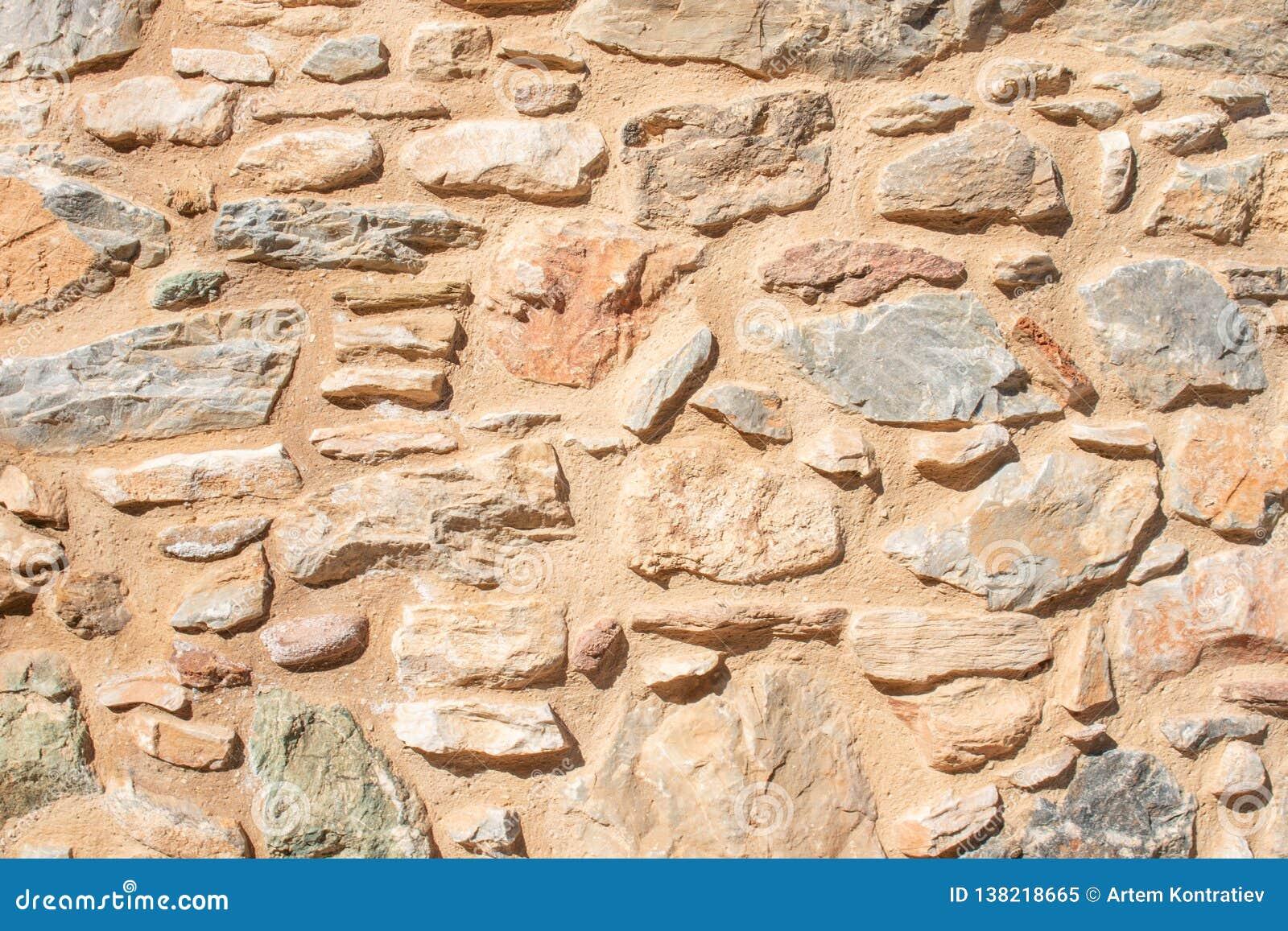 Textuur van een steenmuur De oude achtergrond van de de muurtextuur van de kasteelsteen Van de Brikssteen en muur textuur