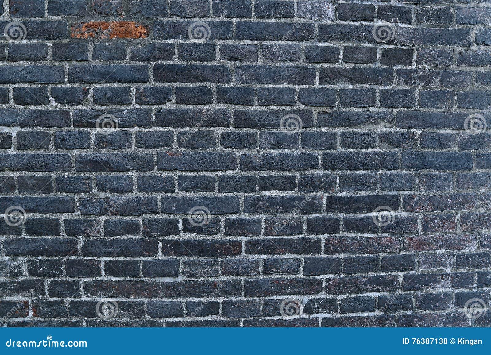 Bakstenen Binnenmuur Behandelen : Textuur van een zwarte gebrande die bakstenen muur met roet wordt