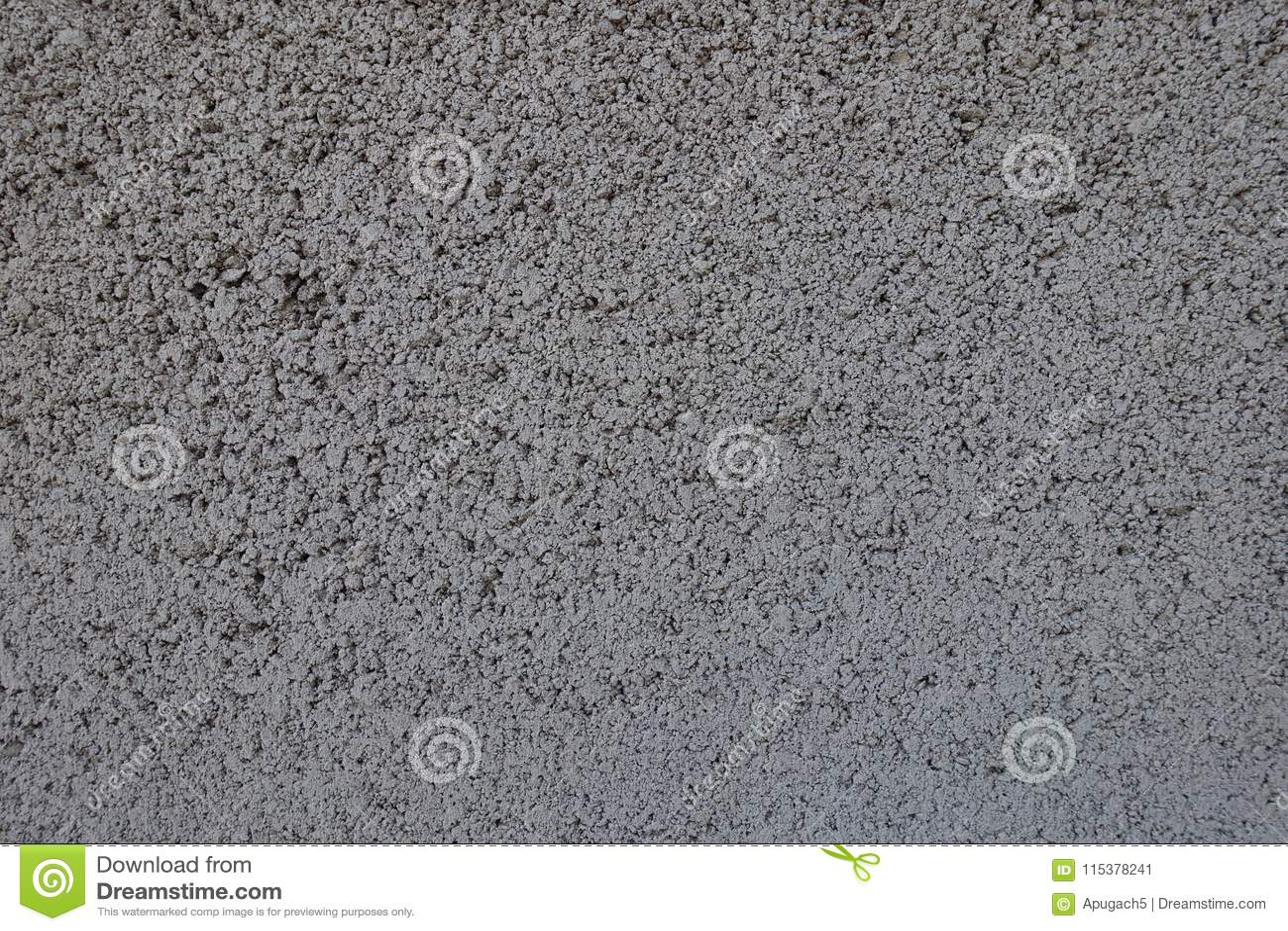 Textuur van korrelig grijs muur vooraanzicht
