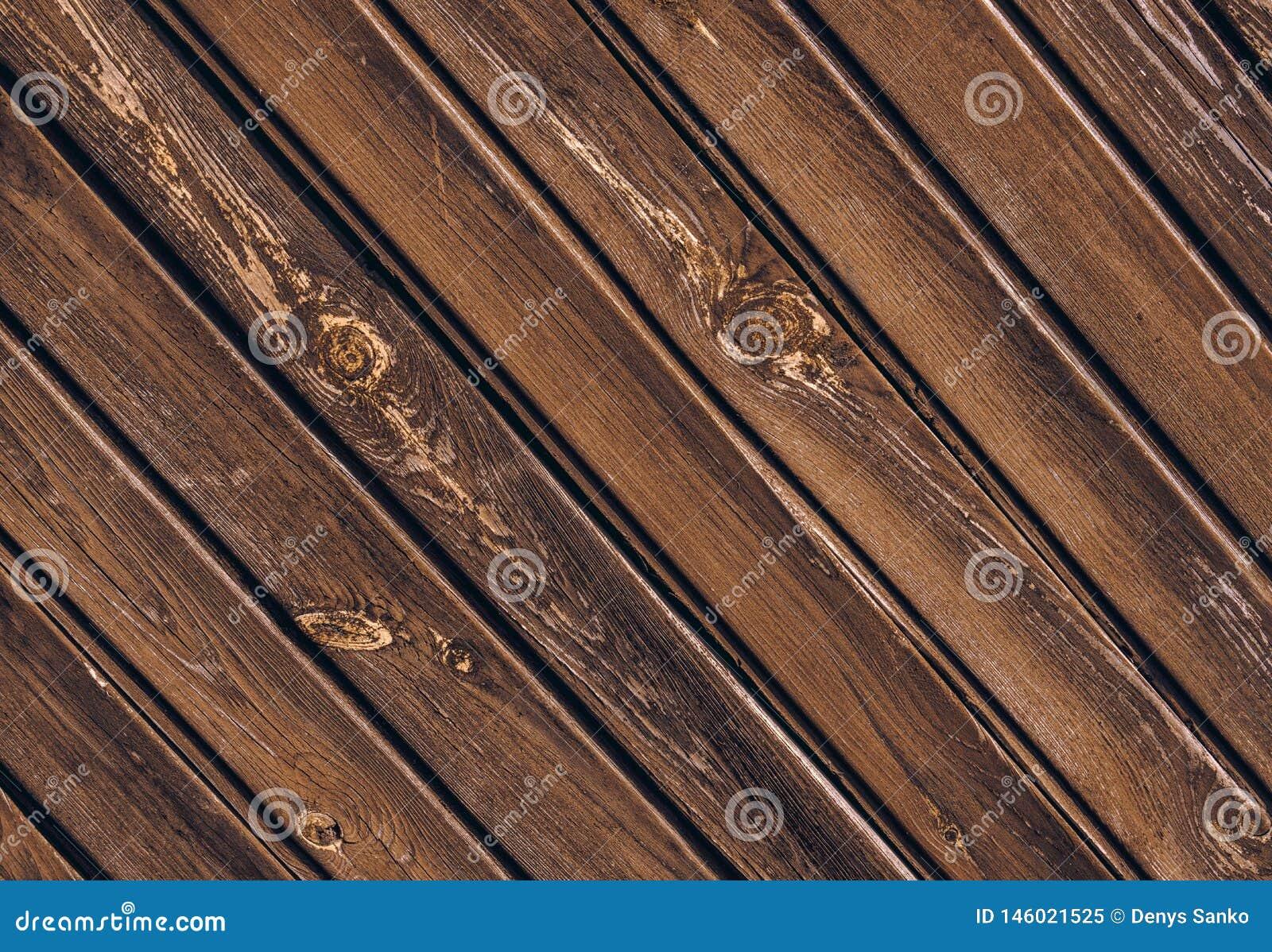 Textuur van oude houten omheining met schuine raad