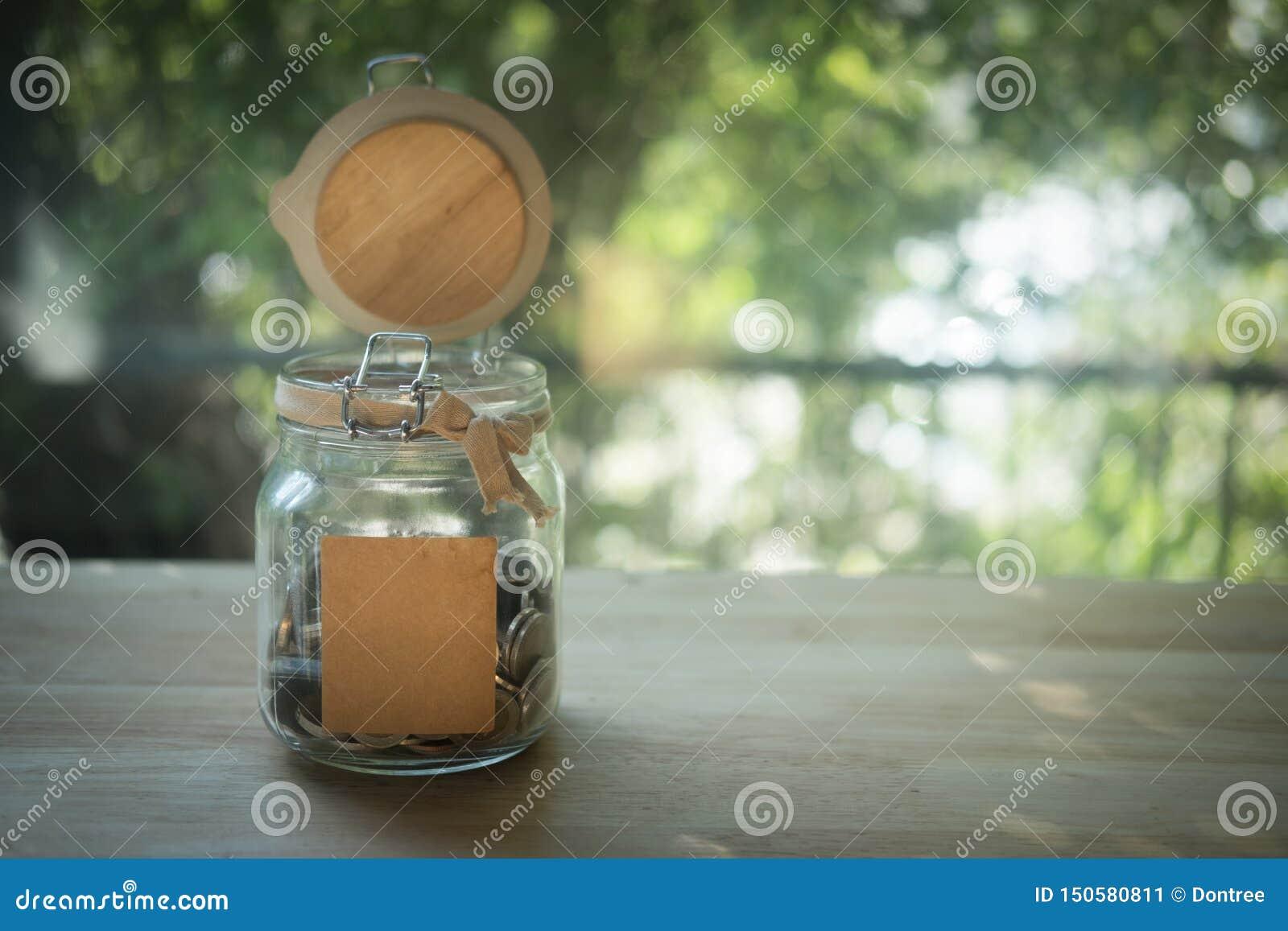 Thai baht in a glass jar