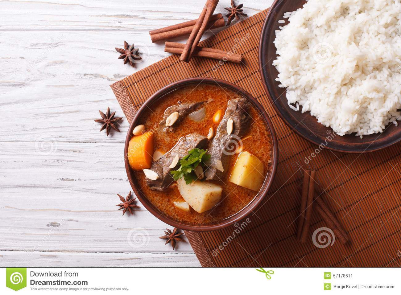 Hot traditional Thai beef massaman curry with peanuts and rice side ...