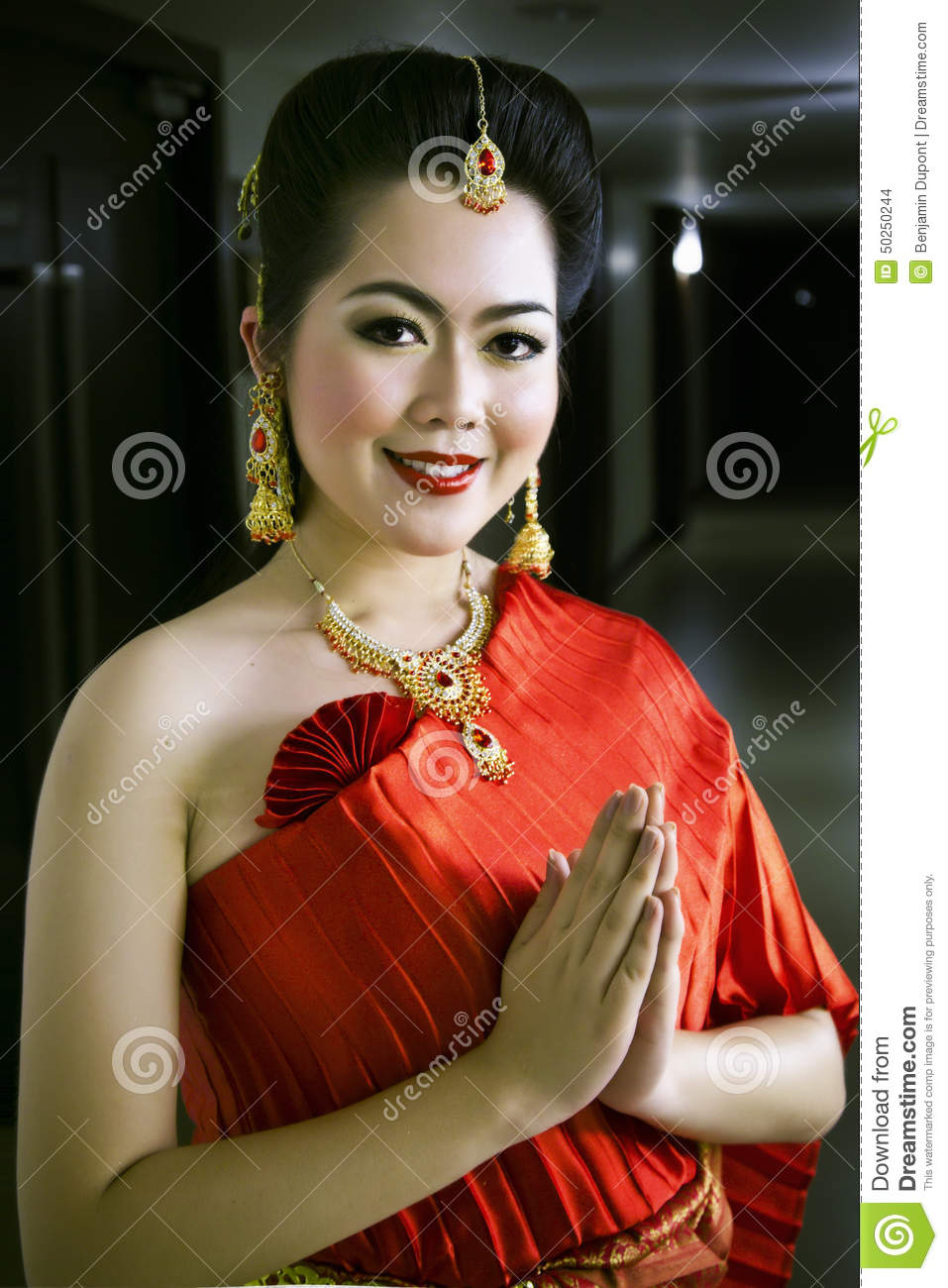 Thai chinese lady in red dress greeting welcome stock photo thai chinese lady in red dress greeting welcome kristyandbryce Images