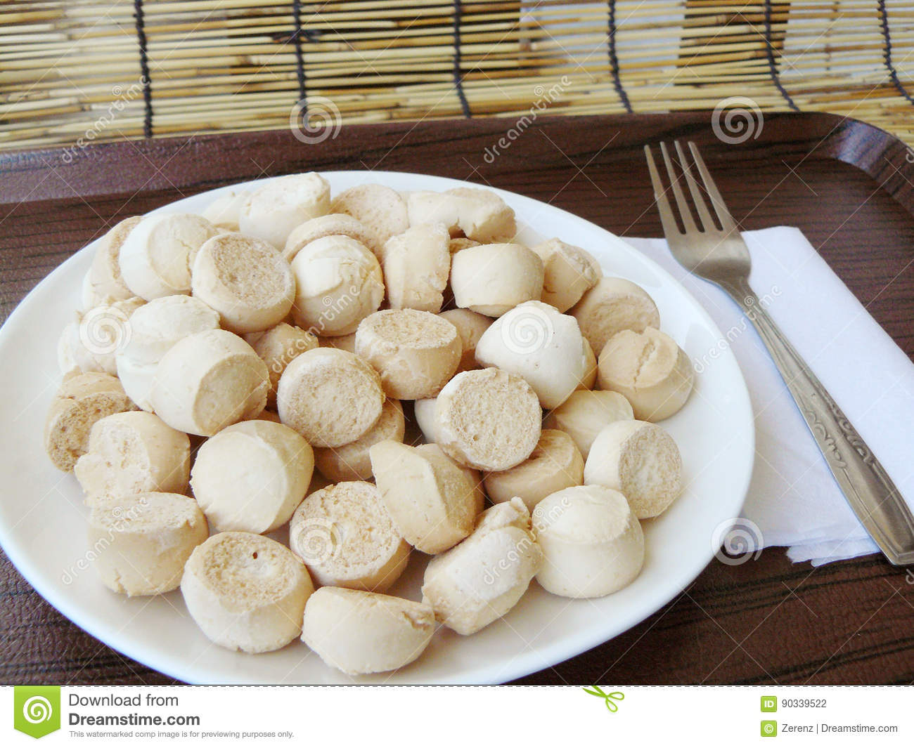 Asia - Asian Thai food, Baking pastry, Thai sweetmeat made of flour, egg  and sugar. Its Thai cookies the name is Kanom Ping, on white plate with  stainless ...