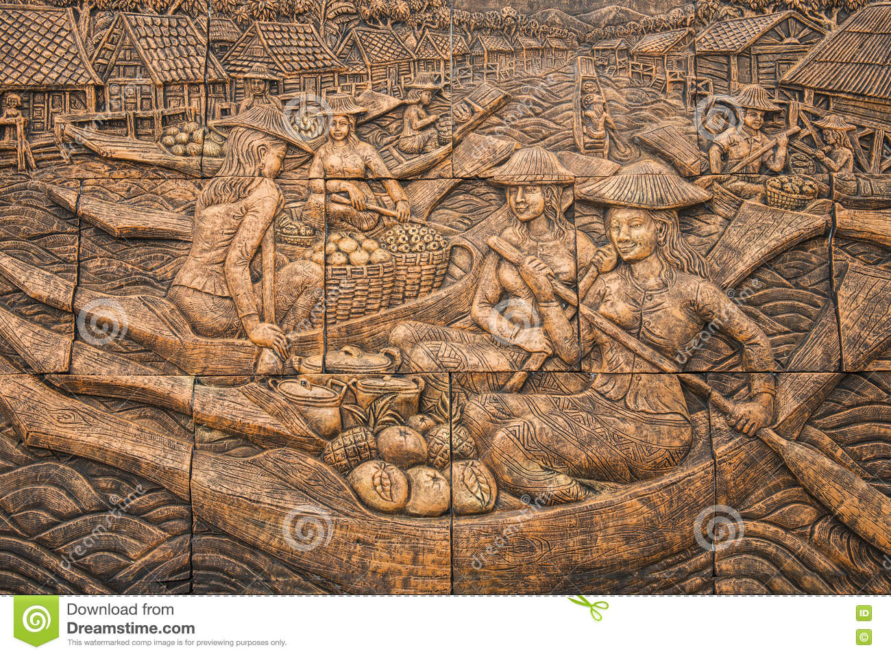 Thai culture stone carving on temple wall stock photo