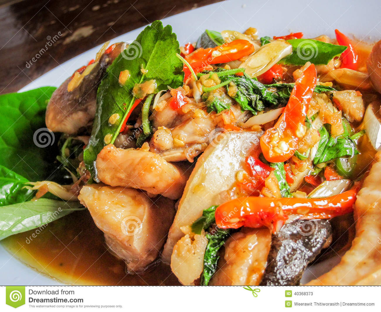 Thai food fish decorated with thai herb spices red chili for 8 spices thai cuisine