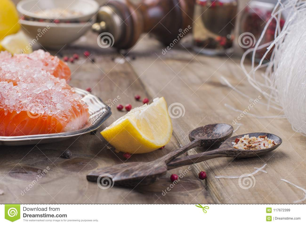 Thai food, ingredients. Rice noodles and salmon, lemon and spices. Dietary food. Stil wabi sabi. Healthy food. Wooden background.