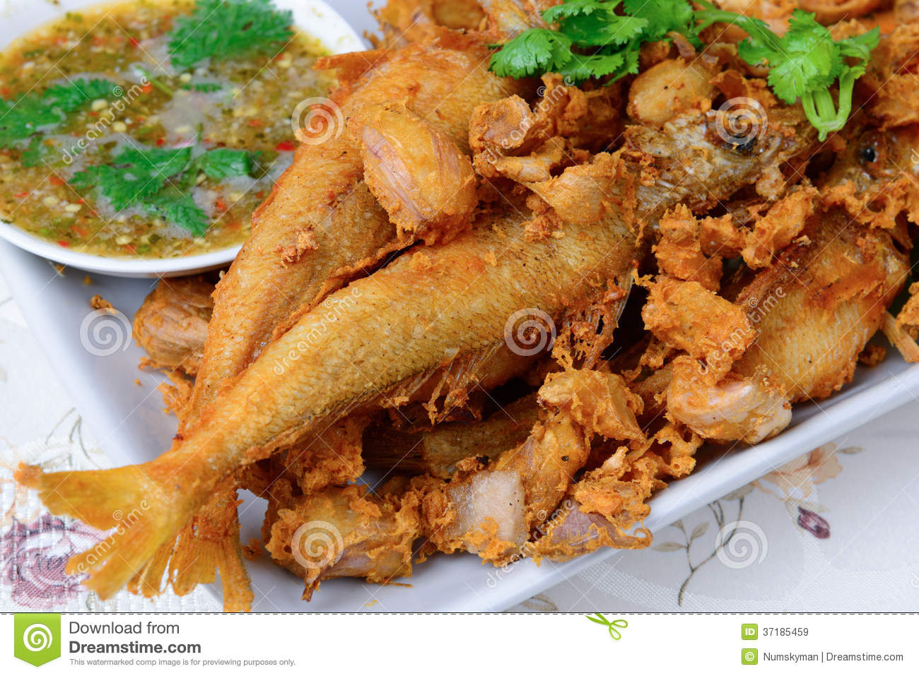 Thai food name is deep fried silver banded fish with for Fish based dog food