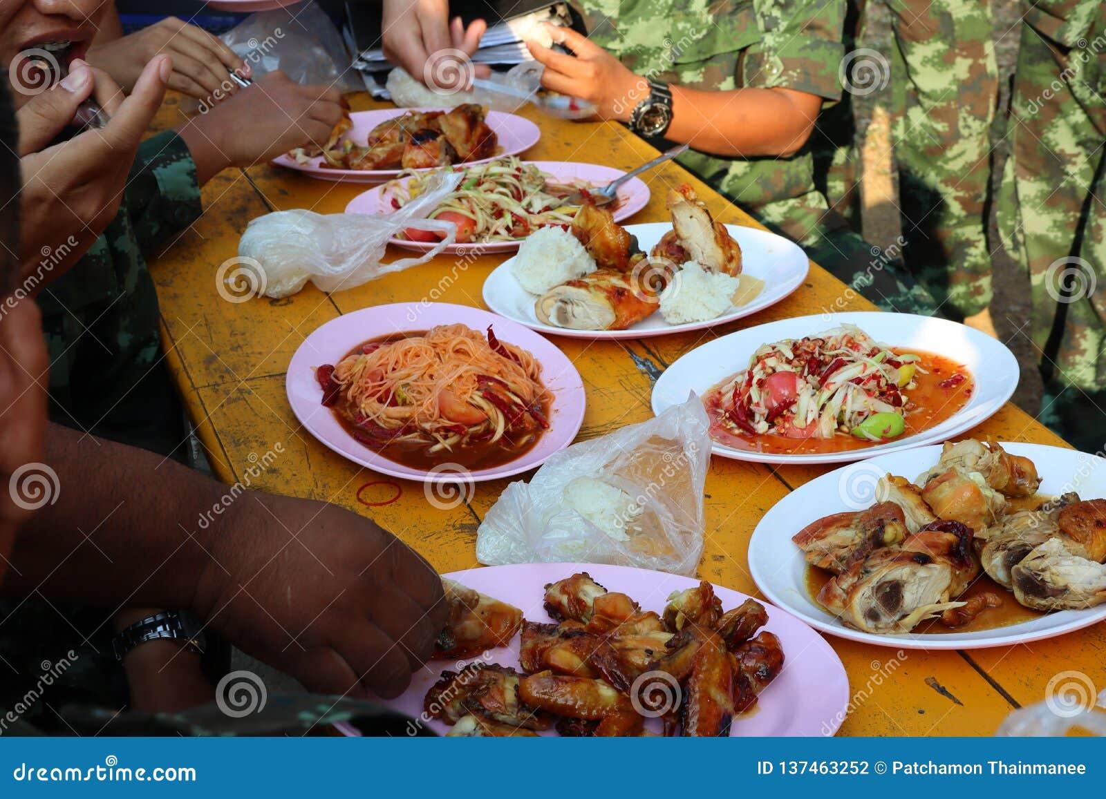 Thai food, papaya salad, grilled chicken in a vintage style restaurant, street food