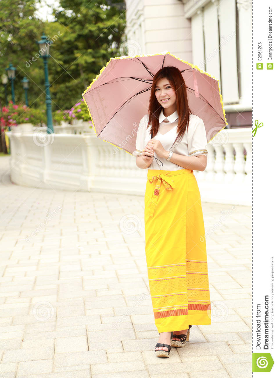 Thai Girl Dressing And Umbrella With Traditional Style