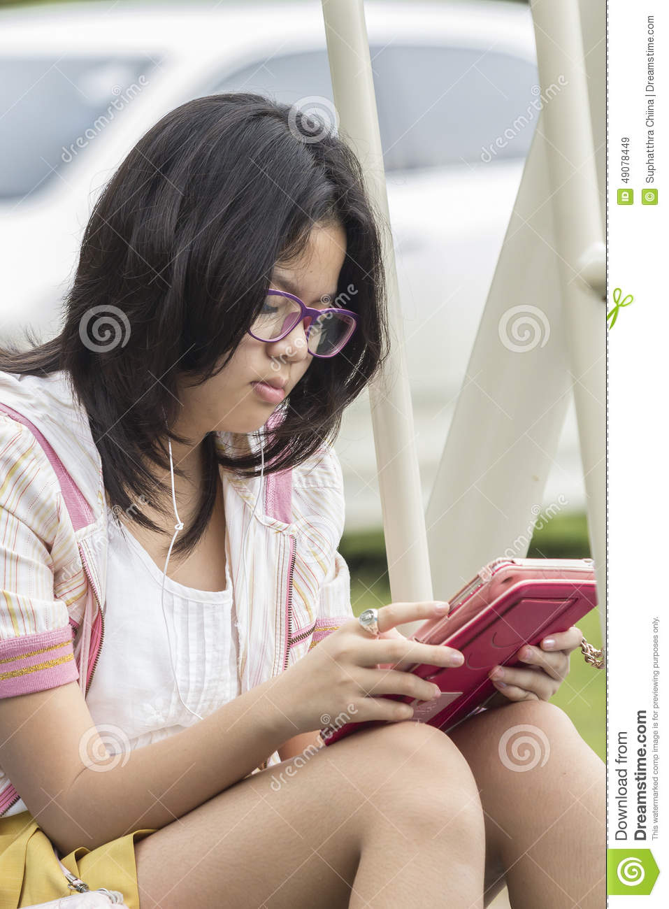 Thai Girl Relaxing With Digital Tablet Stock Photo
