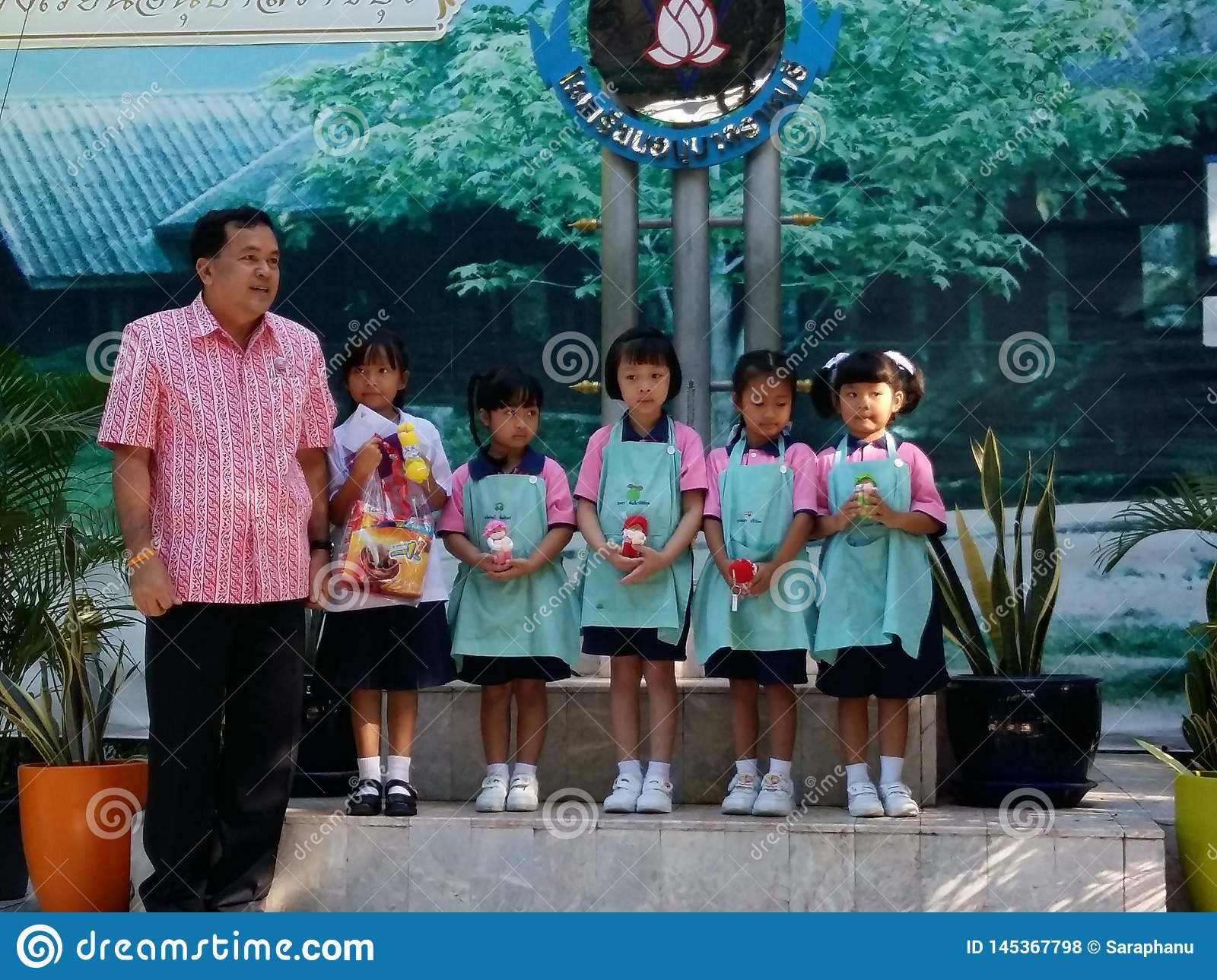 Thai kindergarten and primary school students in morning ceremony