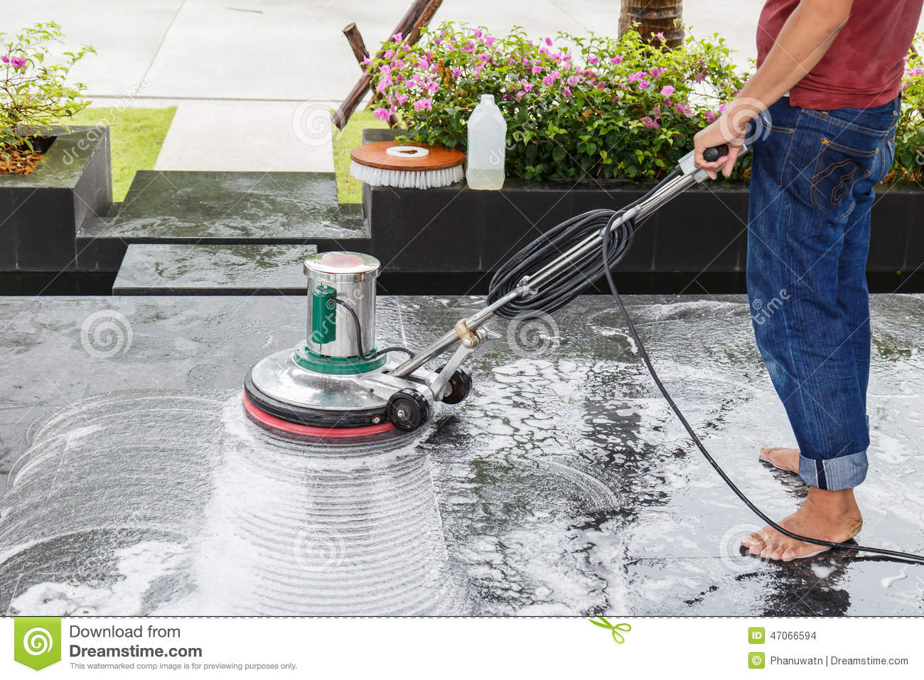 Cleaning black touristic motorbike with water stock image for Floor someone