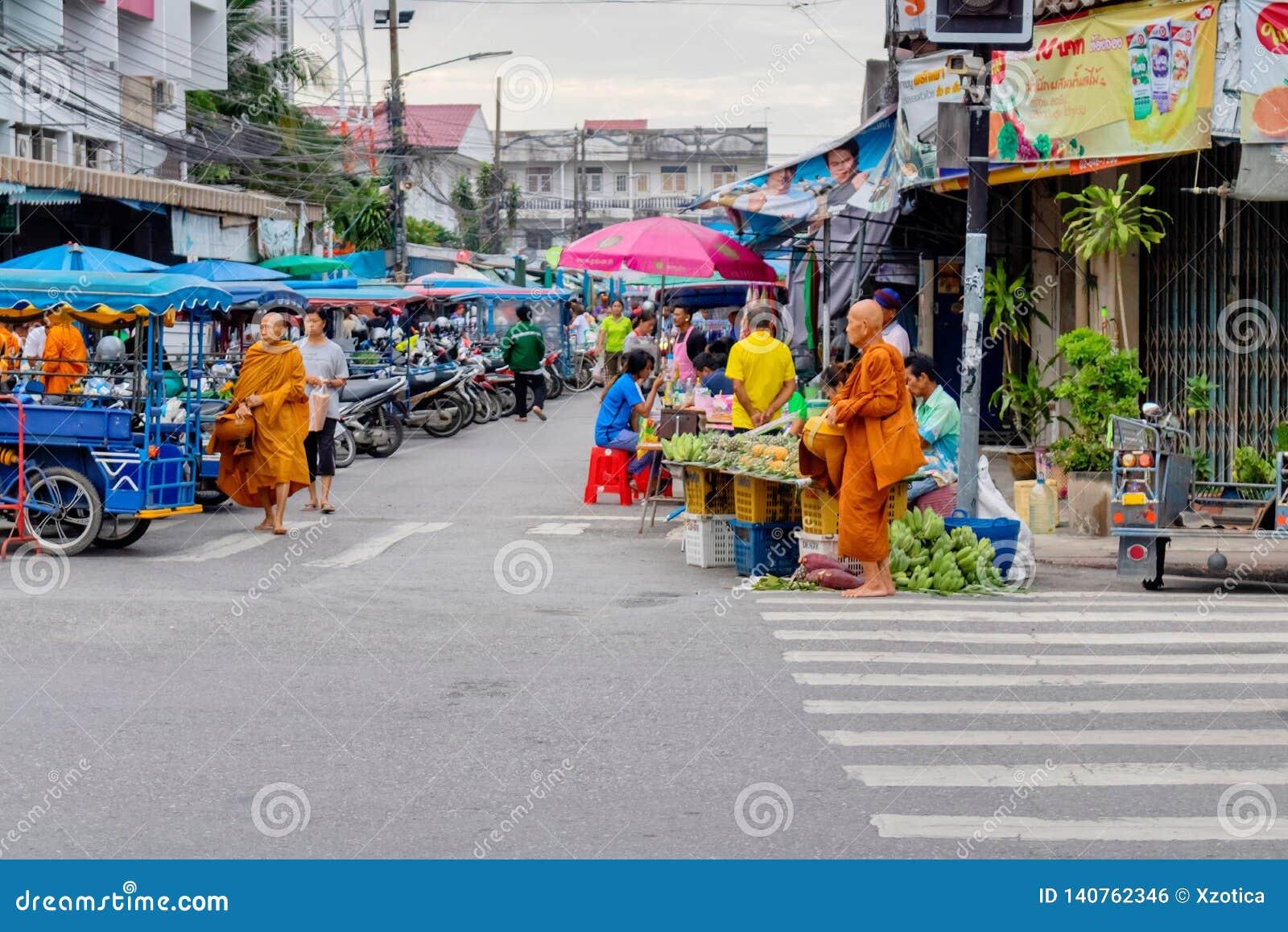 Thai people at Prachuabkirikhan province showing its lifestyle at morning market with many monks walking around. Prachuabkirikhan