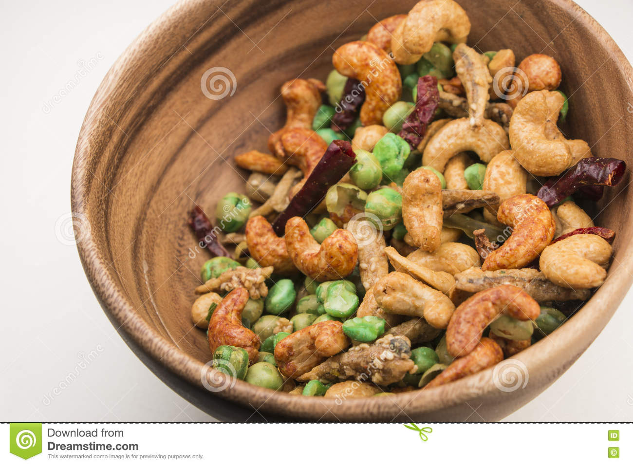 Thai Spicy Mixed Nuts In Wooden Bowl Stock Image